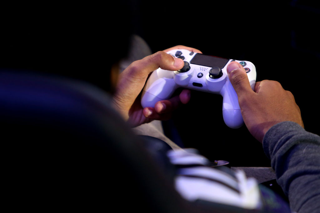 A detailed view of a PS4 controller as players practice during day one of the 2019 ePremier League Finals at Gfinity Arena on March 28, 2019 in London, England.
