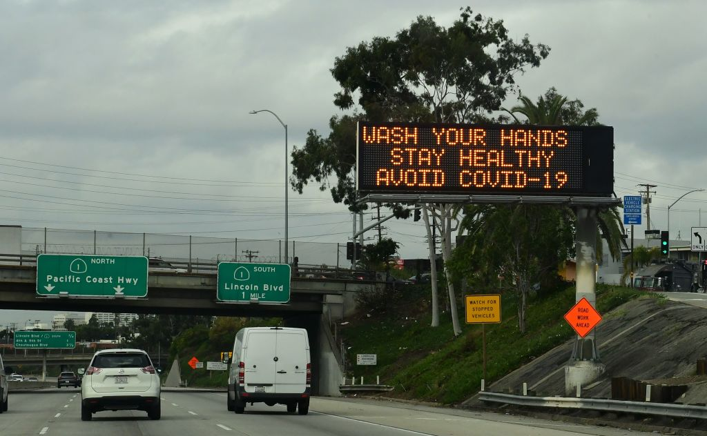A traffic reminder to maintain personal hygiene greets drivers on a Los Angeles freeway on Mar. 16, 2020.