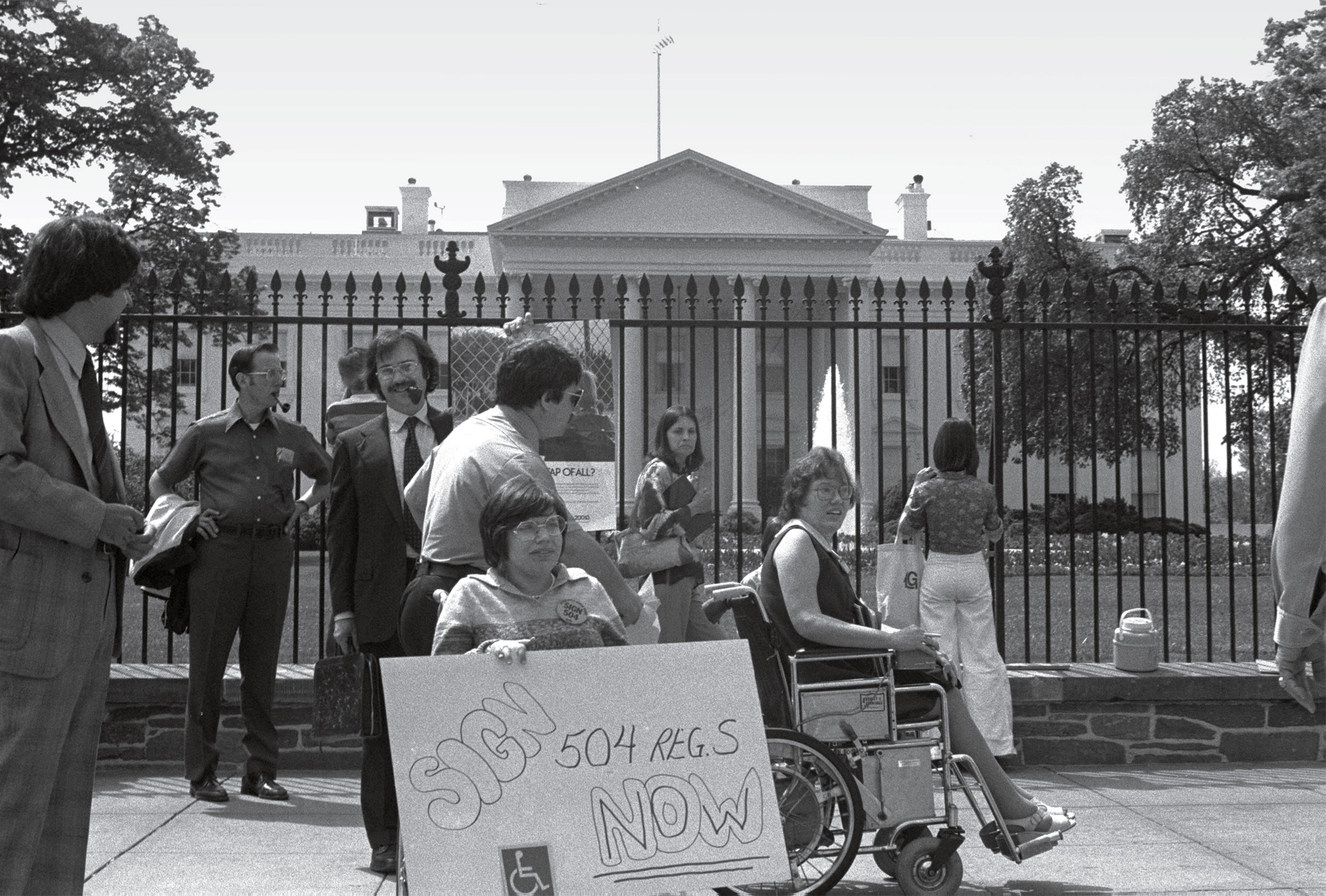 Heumann, center, with fellow activists outside the White House in April 1977.