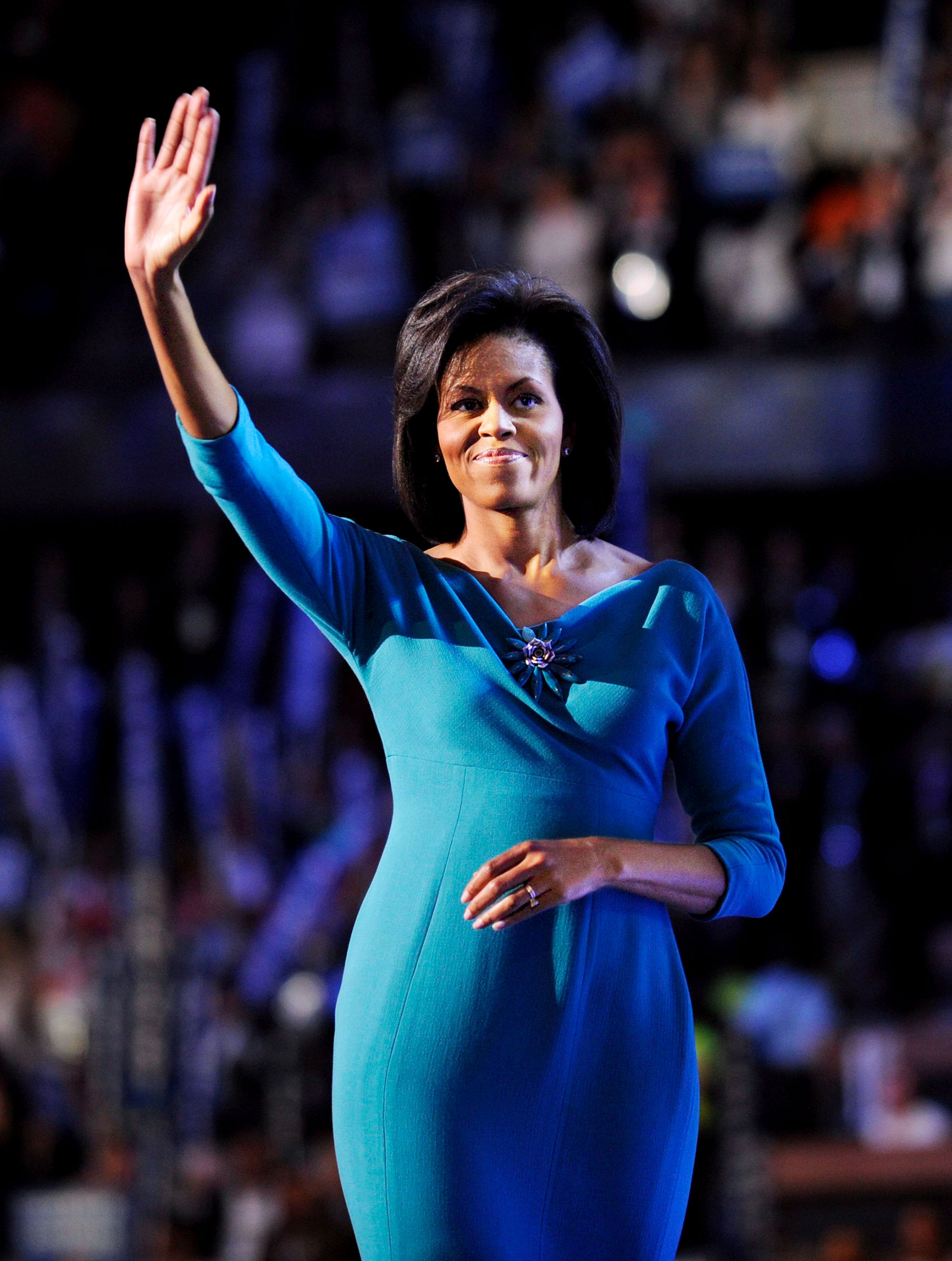 Michelle Obama waves after addressing the 2008 Democratic National Convention in Denver, August 25, 2008.
