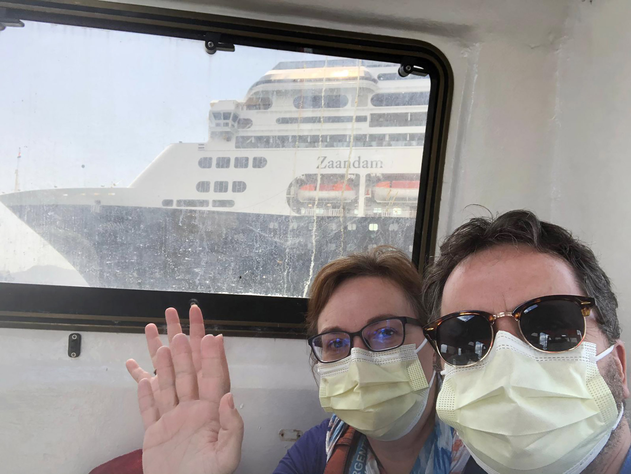 Laura Gabaroni and her husband Juan Huergo take a selfie on board a tender after they were evacuated from the Zaandam cruise ship near the Panama Canal on March 28, 2020.
