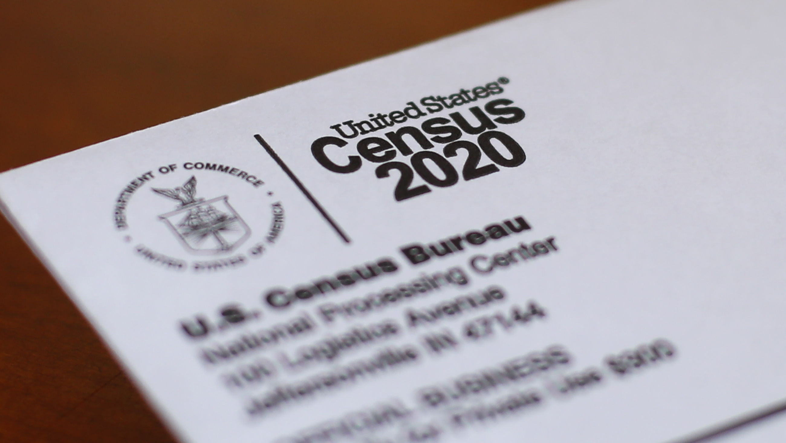 An envelope containing a 2020 census letter mailed to a U.S. resident in Detroit, Michigan is seen on April 5, 2020.