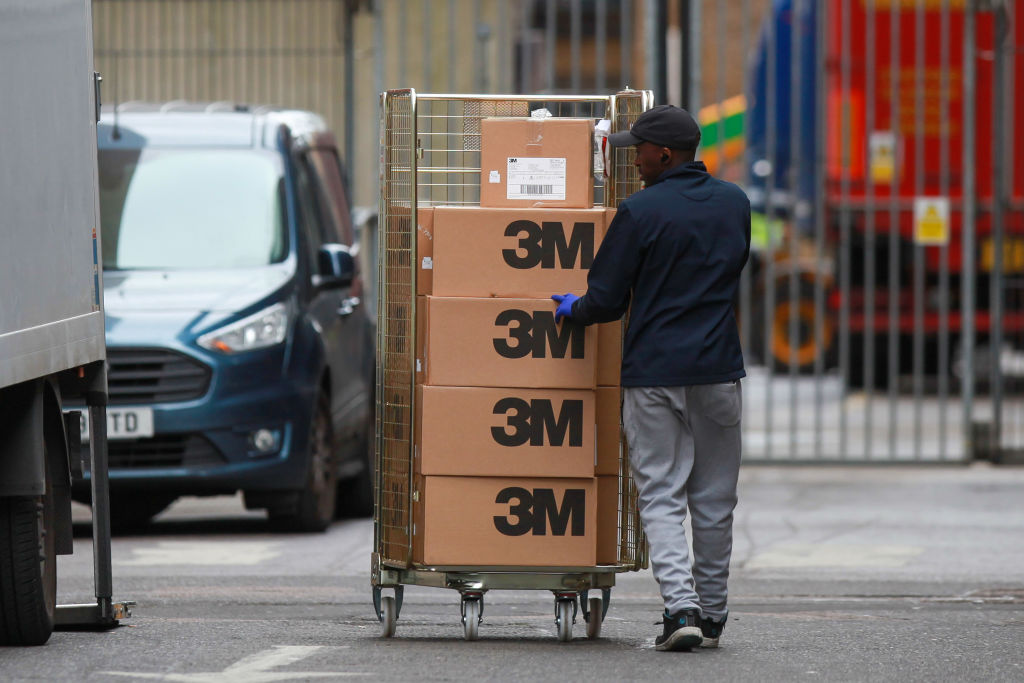 A worker loads boxes, branded with 3M Co. into a truck at The Royal London Hospital, operated by the Barts Health NHS Trust, in London, U.K., on April 2, 2020.