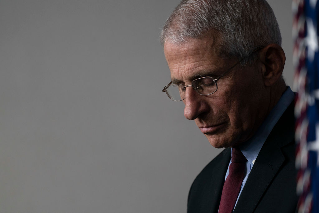Dr. Anthony Fauci, Director of the National Institute of Allergy and Infectious Diseases listens as U.S. President Donald Trump answers questions in the press briefing room with members of the White House Coronavirus Task Force on April 4 in Washington, DC.