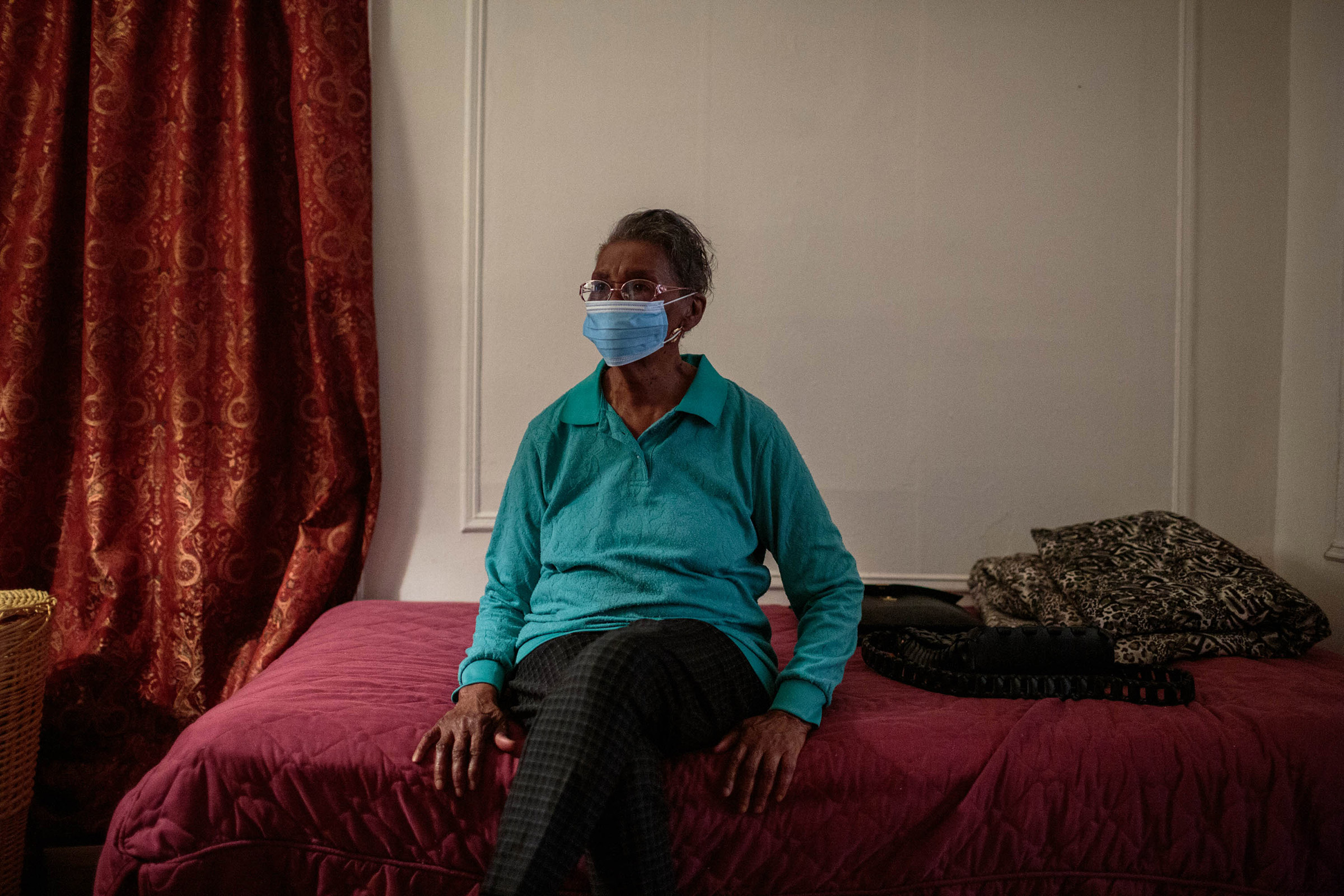 Community activist Blanche Romey watches TV in her bedroom after checking up on her close friends in the Bushwick neighborhood of Brooklyn, NY, on April 3. They are all in their 80s, and as the reality of the pandemic sets in, Blanche tries to check in with them daily.