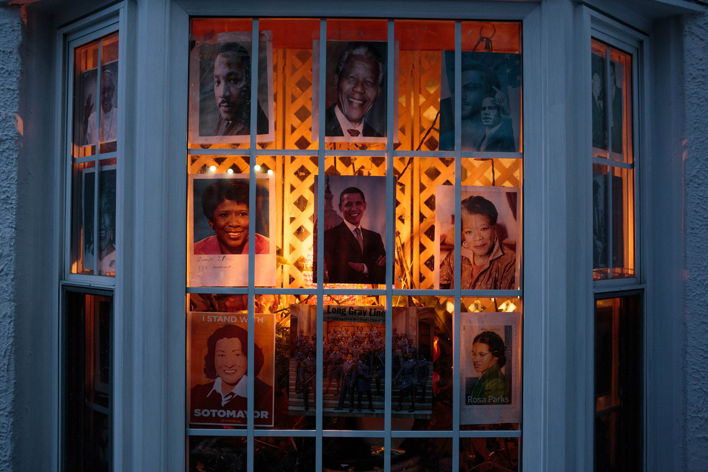 The front window of the Romey home in Bushwick is decorated with pictures of Blanche's idols, ranging from Obama, Rosa Parks, Pope Francis, and a recent photograph of young black women who were recently admitted into West Point. Blanche hopes that the young neighborhood kids walking by will notice them and find some inspiration.