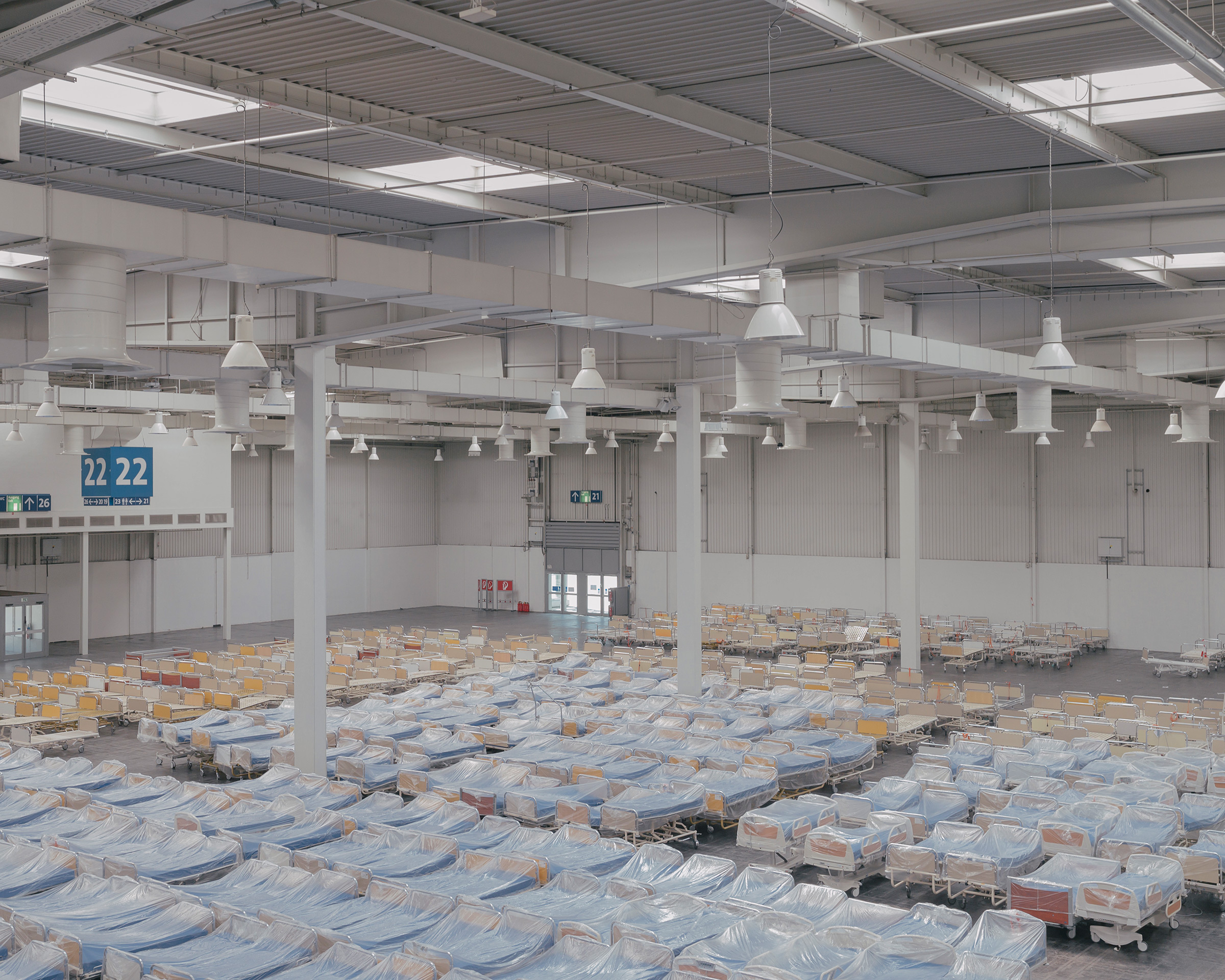 Hospital beds are set up on April 4 at a new hospital for treating coronavirus in an exhibition hall at the Hannover Messe trade fair in Hannover. Five hundred beds will be available across two halls.