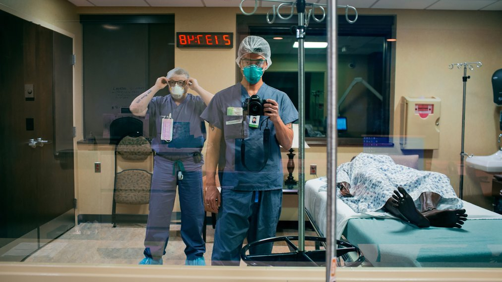 Paramedic Danny Kim photographs himself and his partner for the night shift, Brian Moriarty, beside a manikin patient at HolyName Medical Center in Teaneck, N.J., on March30. Kim made a visual diary of work being done in one community reeling from the COVID-19 pandemic