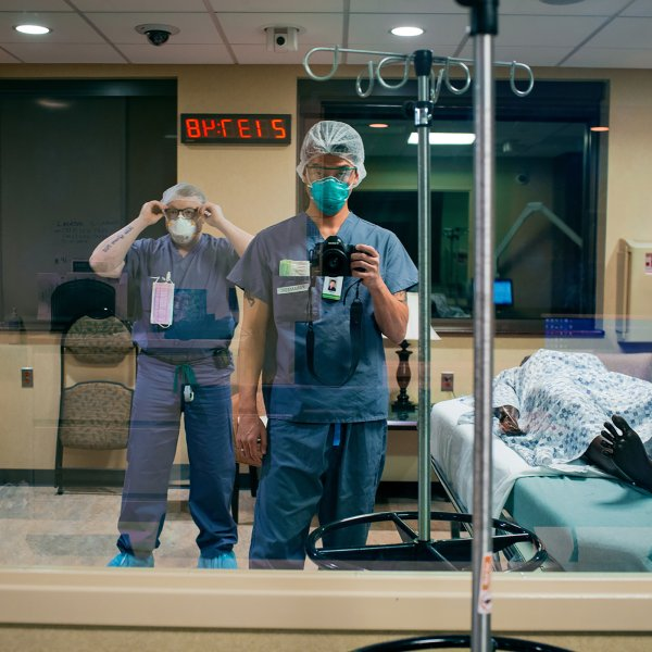 Paramedic Danny Kim photographs himself and his partner for the night shift, Brian Moriarty, beside a manikin patient at Holy Name Medical Center in Teaneck, N.J., on March 30. Kim made a visual diary of work being done in one community reeling from the COVID-19 pandemic