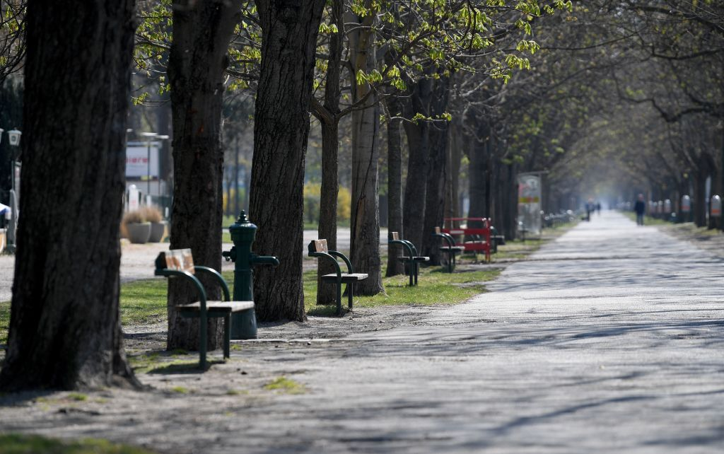Empty benches on the main alley of the Prater public park are pictured during the novel coronavirus pandemic in Vienna on April 6, 2020. - Austria could start easing its coronavirus lockdown measures from next week, Chancellor Sebastian Kurz said on April 6, 2020, but warned that this depended on citizens abiding by social distancing rules.