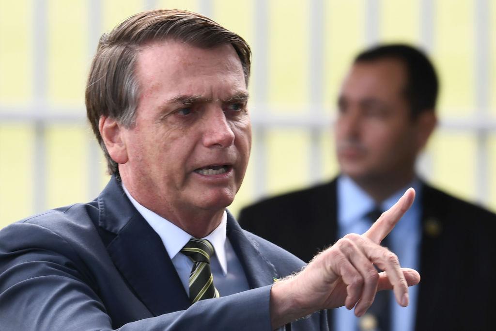 Brazilian President Jair Bolsonaro talks to supporters as he leaves Alvorada Palace in Brasilia, Brazil on April 6, 2020