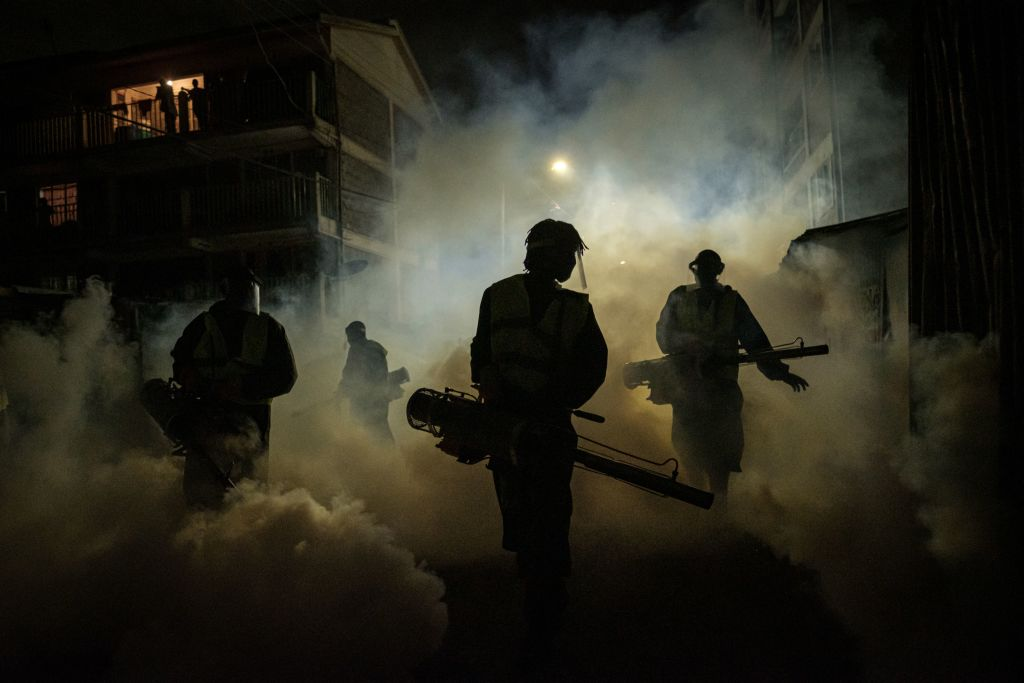 Volunteers from Sonko Rescue Team, an NGO privately funded by Nairobi Governor Mike Sonko, fumigate a street to curb the spread of COVID-19 during a joint operation with Nairobi county during a 7pm-5am curfew at a residential area in Nairobi, Kenya, on April 6, 2020.