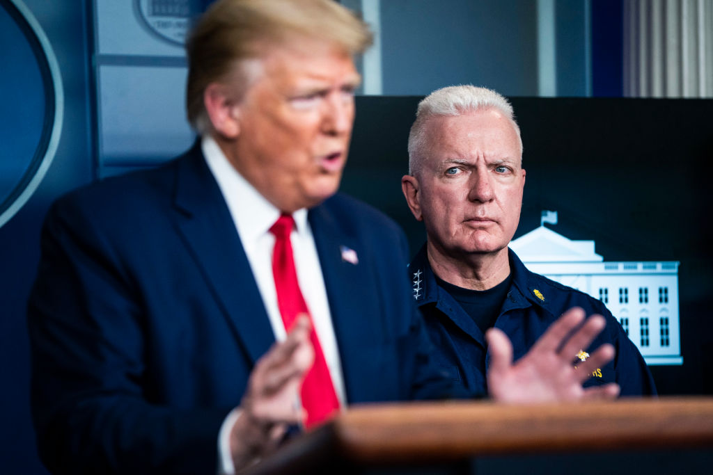 Admiral Brett Giroir, assistant secretary of Health and Human Services, listens as President Donald J. Trump speaks with members of the coronavirus task force during a briefing at the White House in Washington, DC., on April 06, 2020.