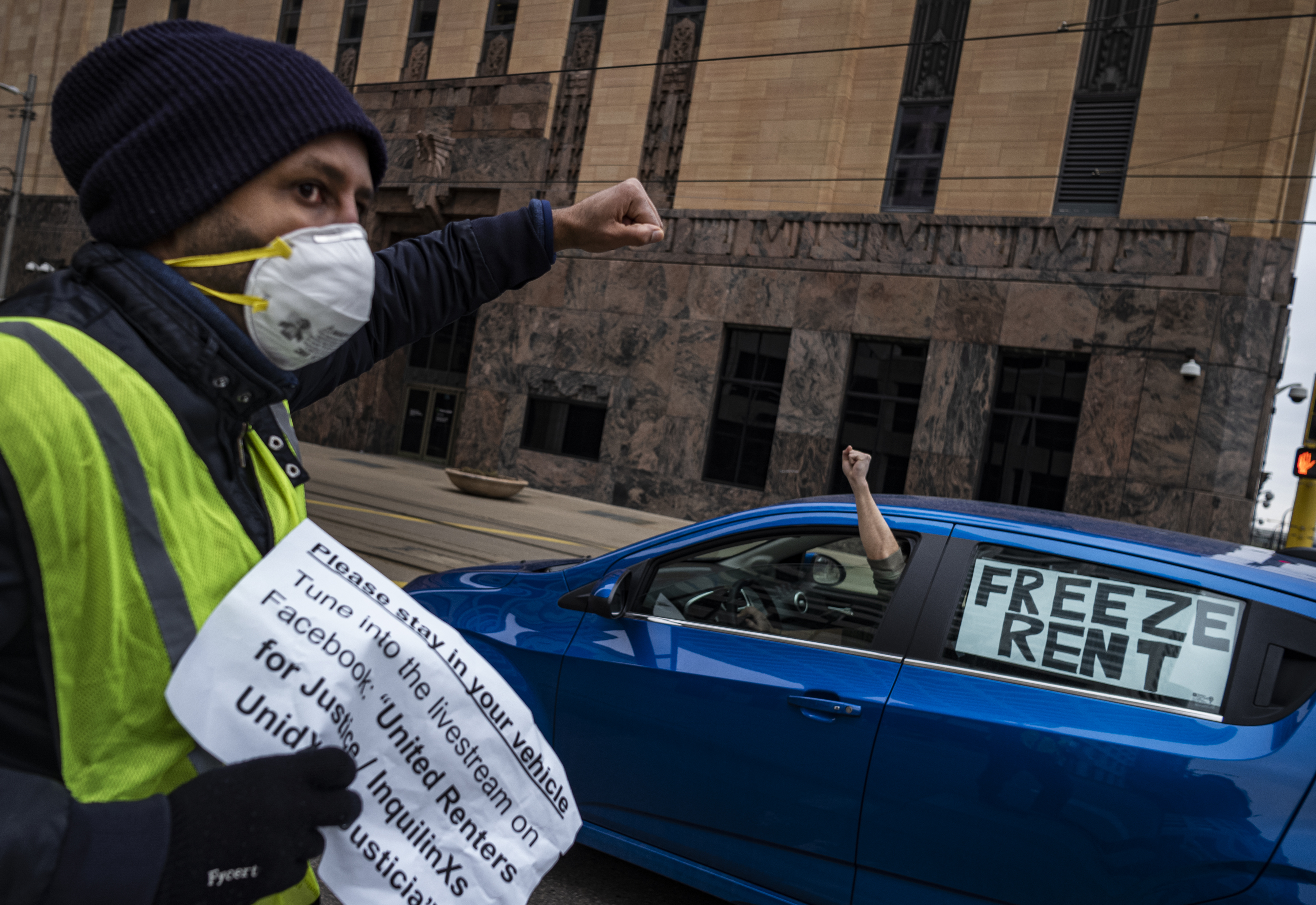 Tenant rights activist Nathan Sirdar helps lead a protest calling for relief for renters and homeowners during the coronavirus-related financial crisis, in Minneapolis, Minnesota on April 8, 2020.