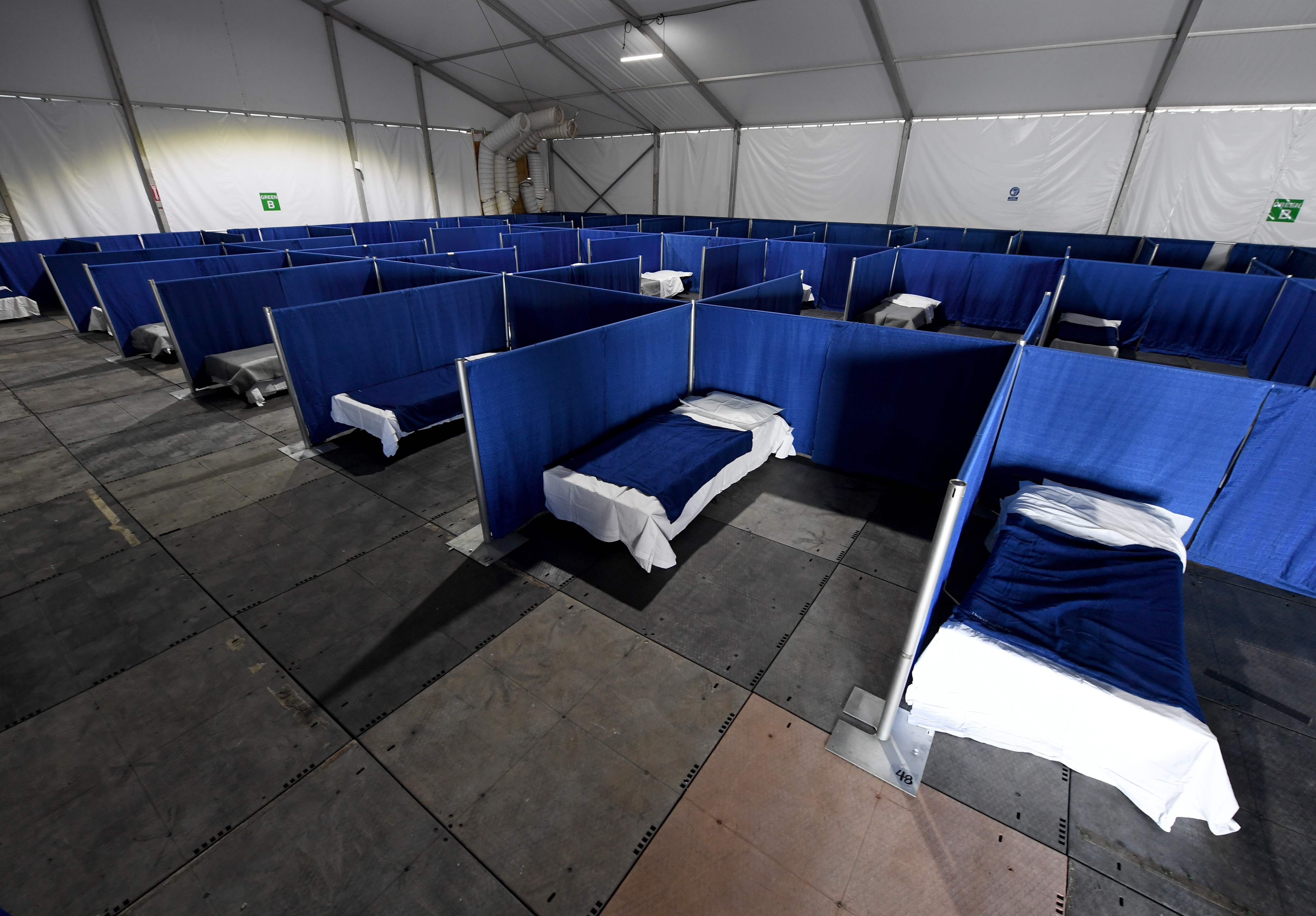 Cots are set up in a tent for homeless people who have nowhere to self-isolate in Las Vegas, Nevada, on April 13, 2020. The center will have separate areas for those requiring quarantine due to COVID-19, those with symptoms who have tested positive, and those who have tested positive but have no symptoms.