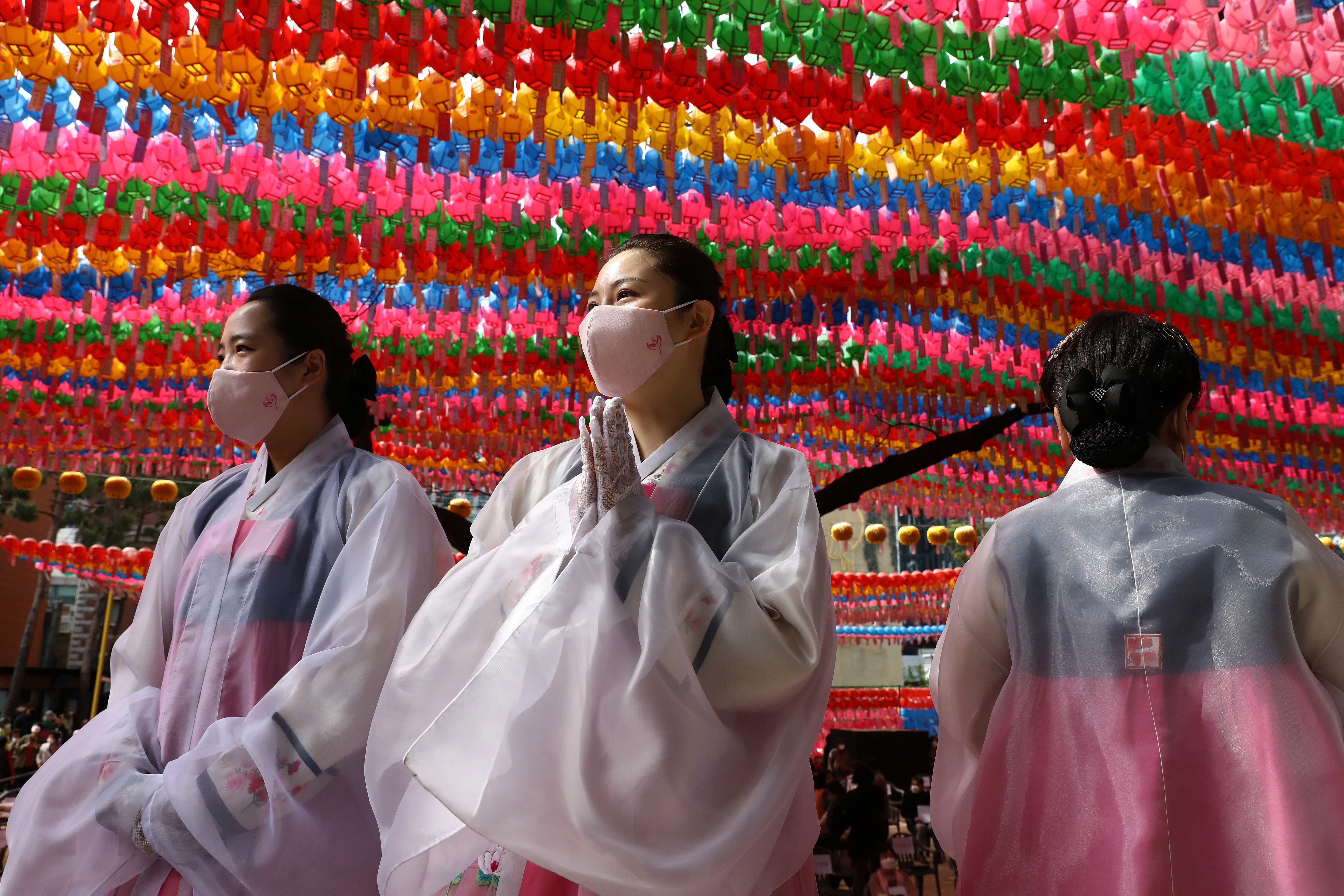 Buddhist believers wear masks as a preventive measure against the coronavirus (COVID-19), as they gather during a birthday of Buddha and service to pray for overcoming the coronavirus (COVID-19) pandemic at Jogyesa Temple on April 30, 2020 in Seoul, South Korea.