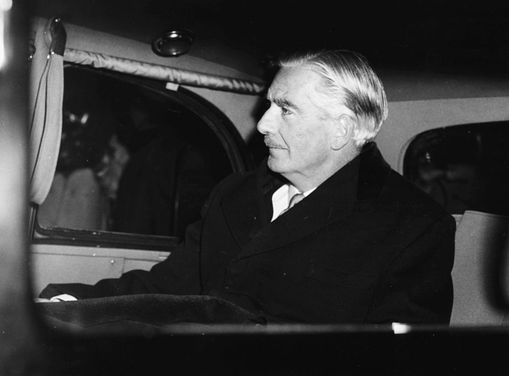 British Prime Minister Sir Anthony Eden in the back of a car, leaving his office at 10 Downing Street for Buckingham Palace, London, January 9th 1957.