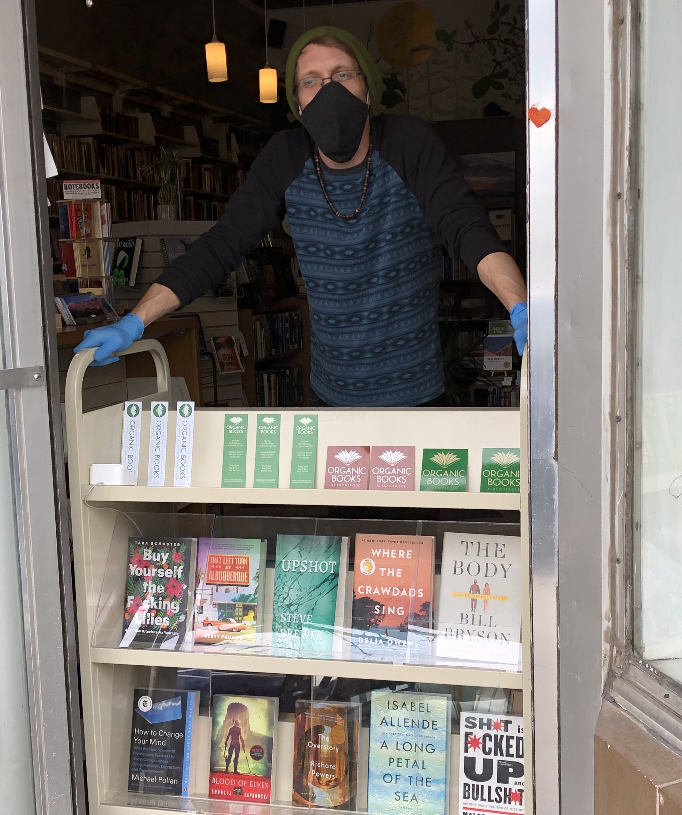 Seth Brewer, a co-owner of Organic Books in Albuquerque, New Mexico, at his bookstore before a stay-at-home order closed it down.