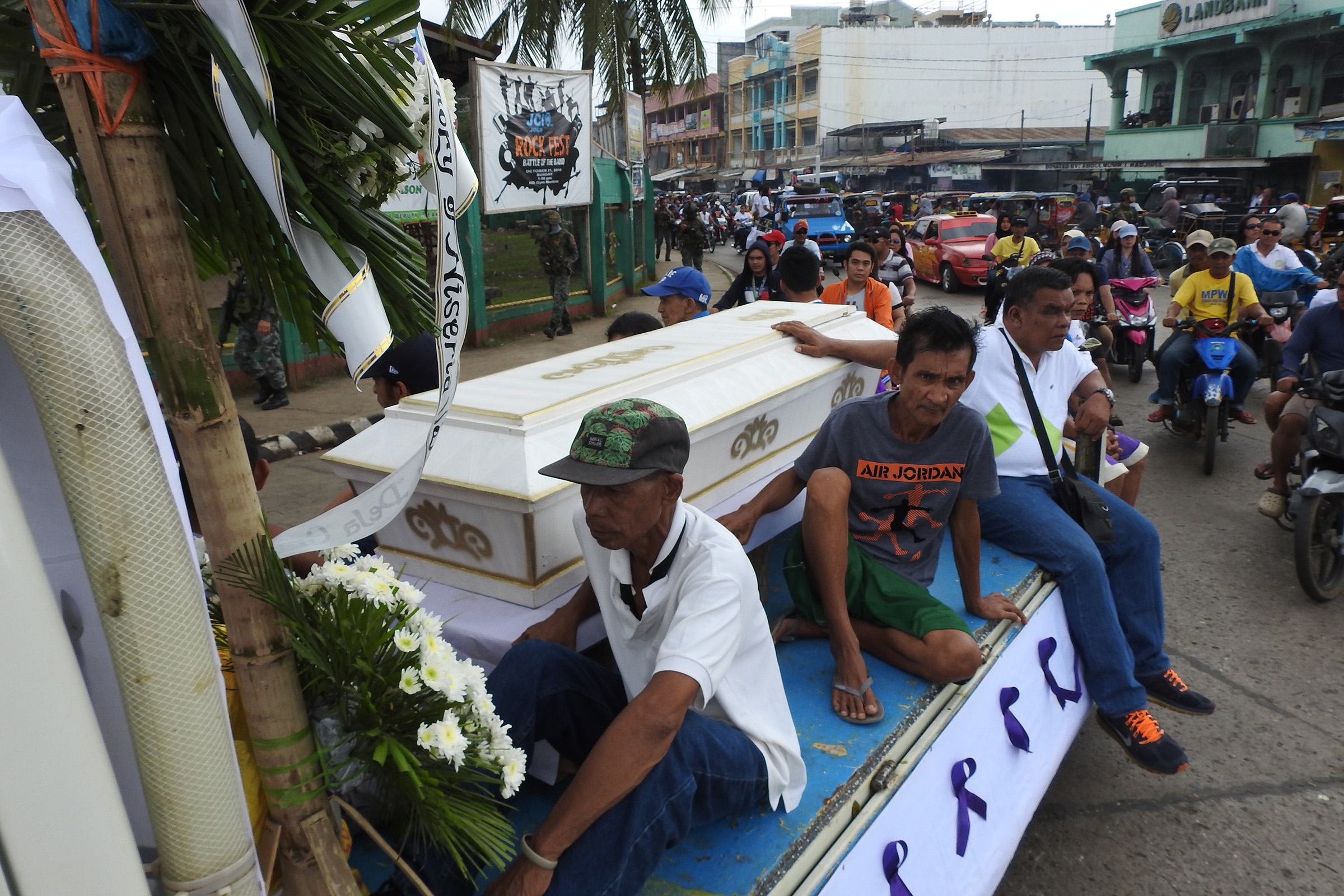 Mourners ride on a hearse during the funeral procession of a victim killed in the Jan. 27, 2019 cathedral bombing in Jolo, Sulu province on the southern island of Mindanao, Philippines.