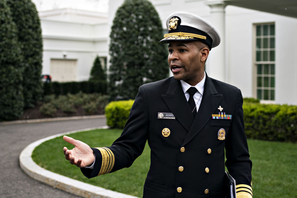 Vice Admiral Jerome Adams, U.S. Surgeon General, speaks to members of the media after a television interview outside of the West Wing of the White House in Washington, D.C., U.S., on Friday, March 20.