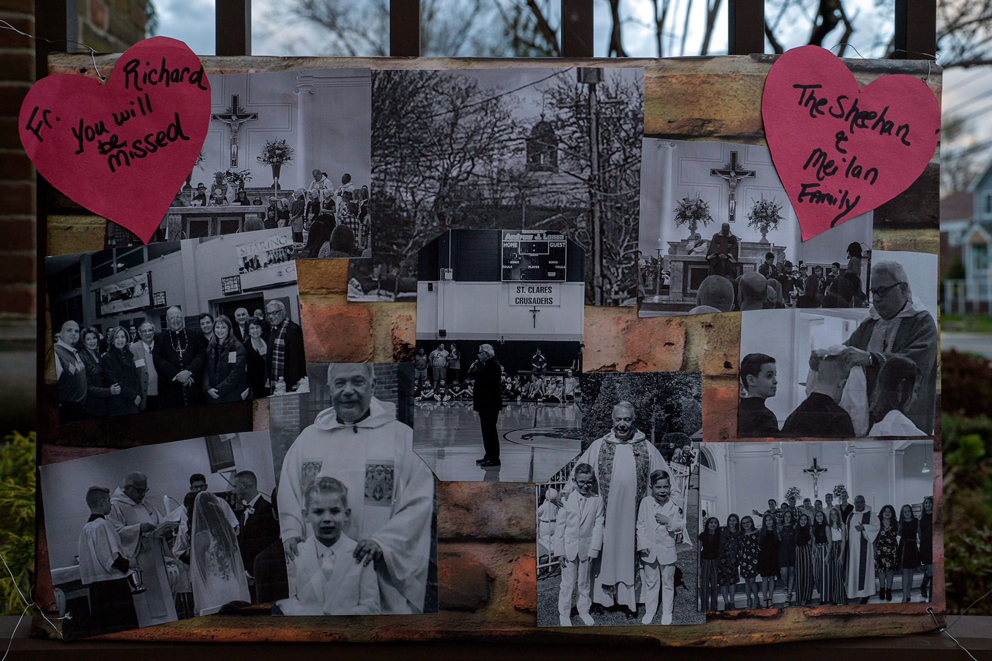 A of collage photographs left at a memorial for Monsignor Richard Guastella, who died from Covid-19 outside the doors of St. Clare Catholic Church in Staten Island, N.Y., on April 10, 2020.