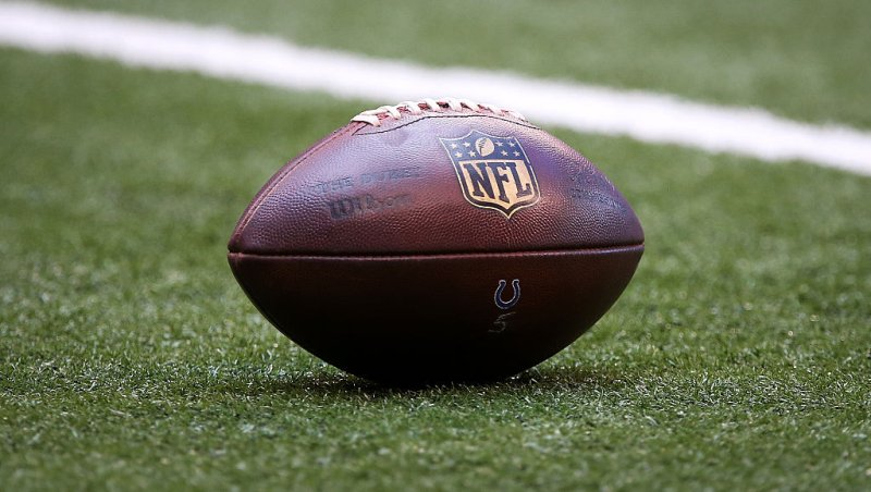 A football sits on the field in the second quarter of a game in Indianapolis, Indiana on Sept. 11, 2016.