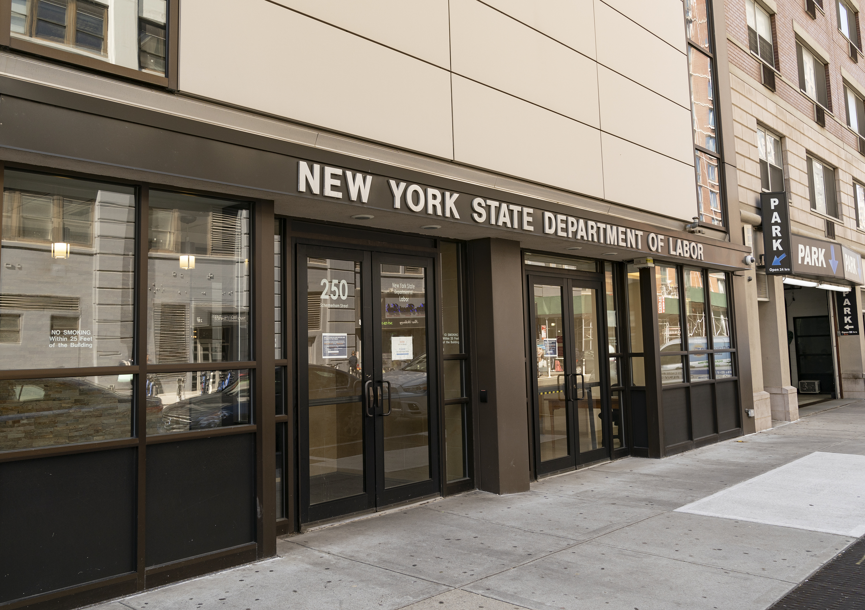 The Brooklyn office of the New York State Department of Labor on March 26, 2020. A sign on the door said the office was closed due to COVID-19 and told people seeking unemployment benefits to apply online or call.