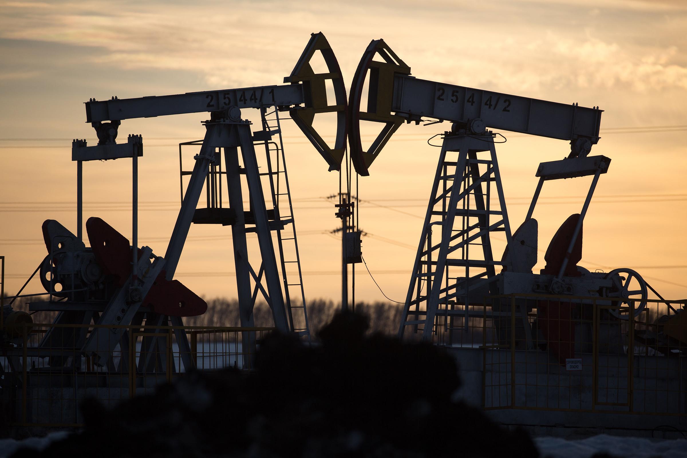 Oil pumping jacks, also known as  nodding donkeys , operate in an oilfield near Almetyevsk, Tatarstan, Russia, on March 11.