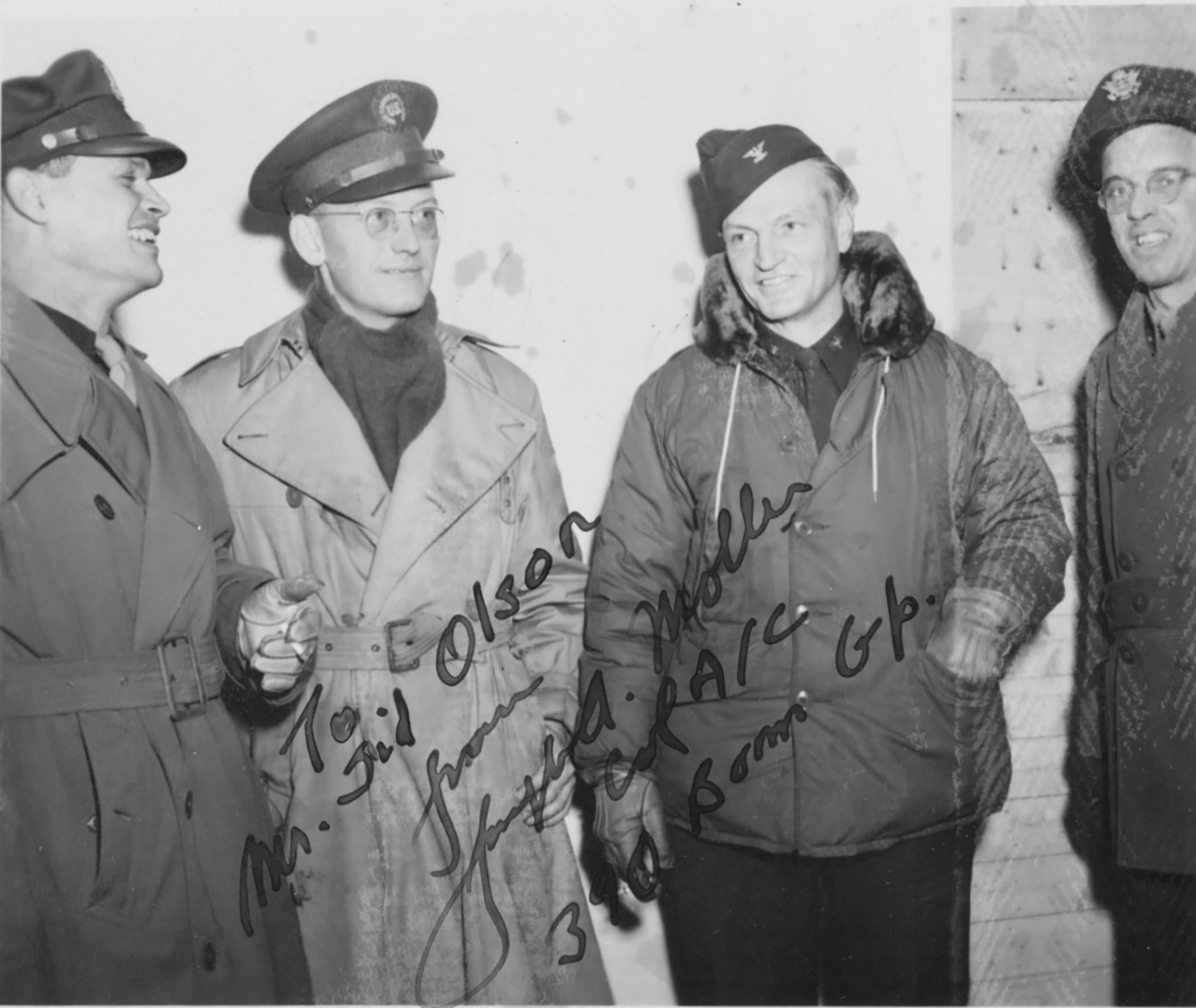 Olson (second from left) visiting U.S. troops somewhere in England in January 1945 and standing next to the 390th Bomb Group's commander Colonel Joseph A. Moller (second from right).