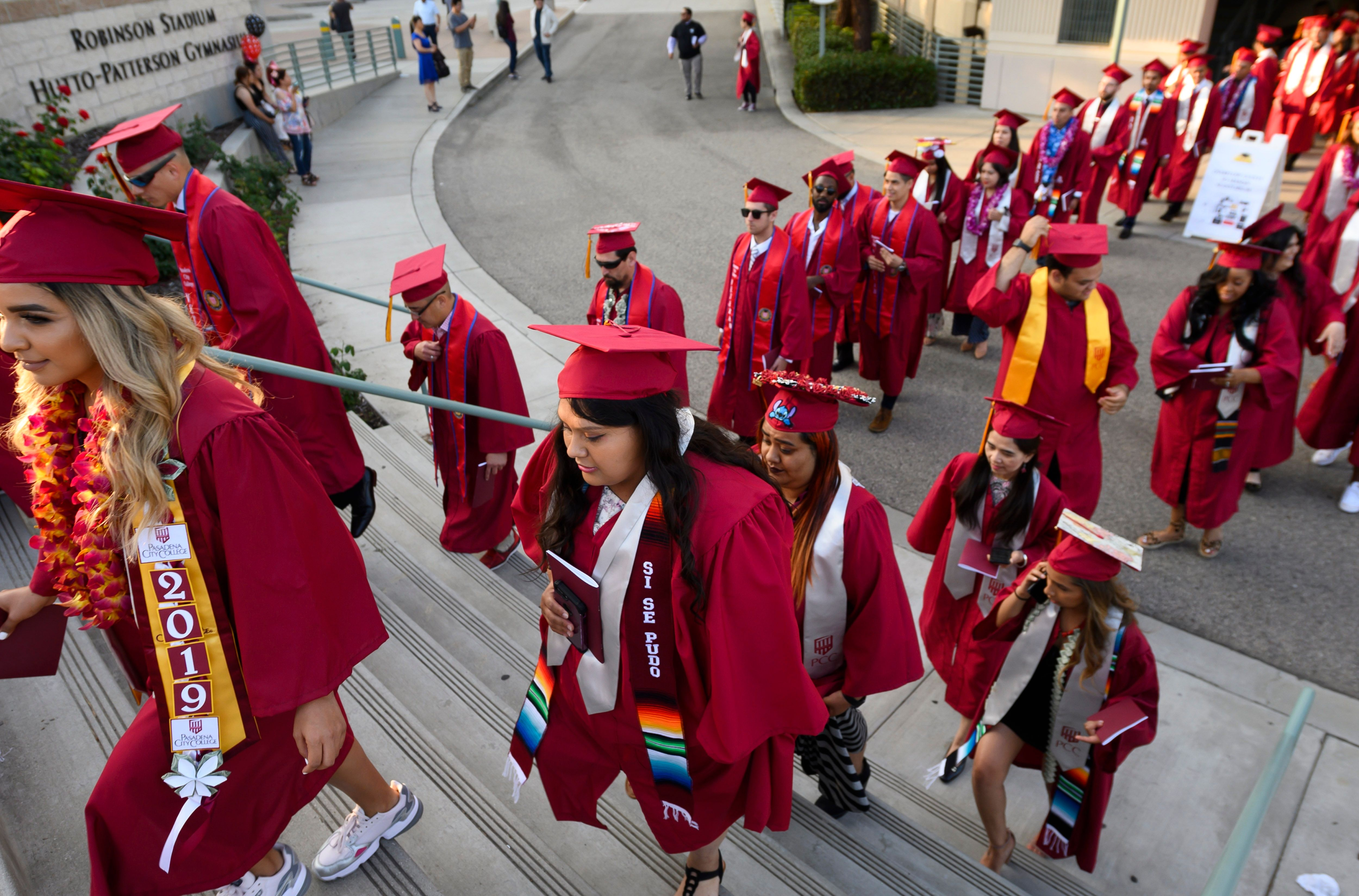Students earning degrees at Pasadena City College participate in the graduation ceremony on June 14, 2019, in Pasadena, California. With 45 million borrowers owing $1.5 trillion, the student debt crisis in the United States has exploded in recent years.
