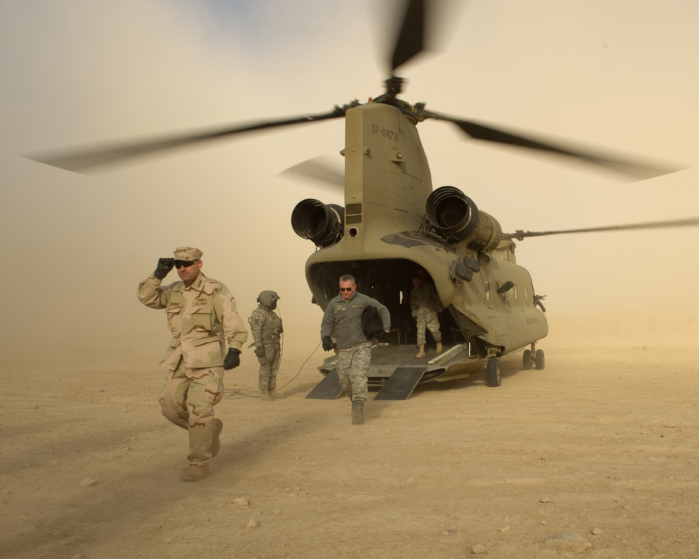 While Supreme Allied Commander of NATO, Admiral Stavridis dismounts a helicopter in Afghanistan outside of Khandahar in 2010.