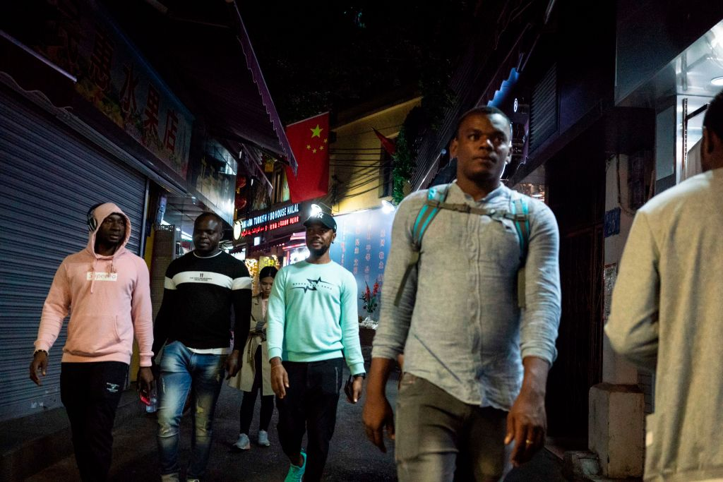 Africans walk in the  Little Africa  district of Guangzhou, China on Mar. 1, 2018.