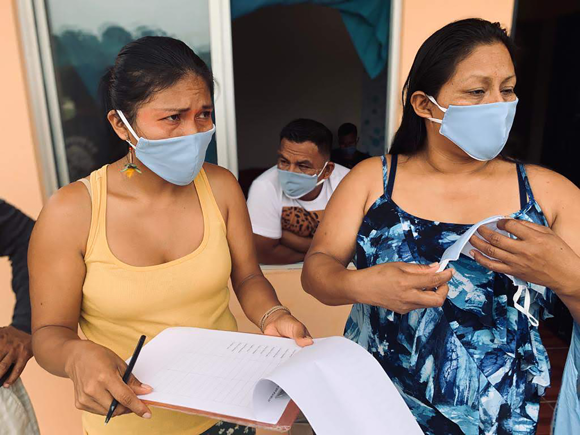 As the COVID-19 pandemic reaches the edge of indigenous territories in the Ecuadorian Amazon, Nemonte Nenquimo (left) and other Waorani leaders have remained in frontier towns to help organize preventative measures for their communities.