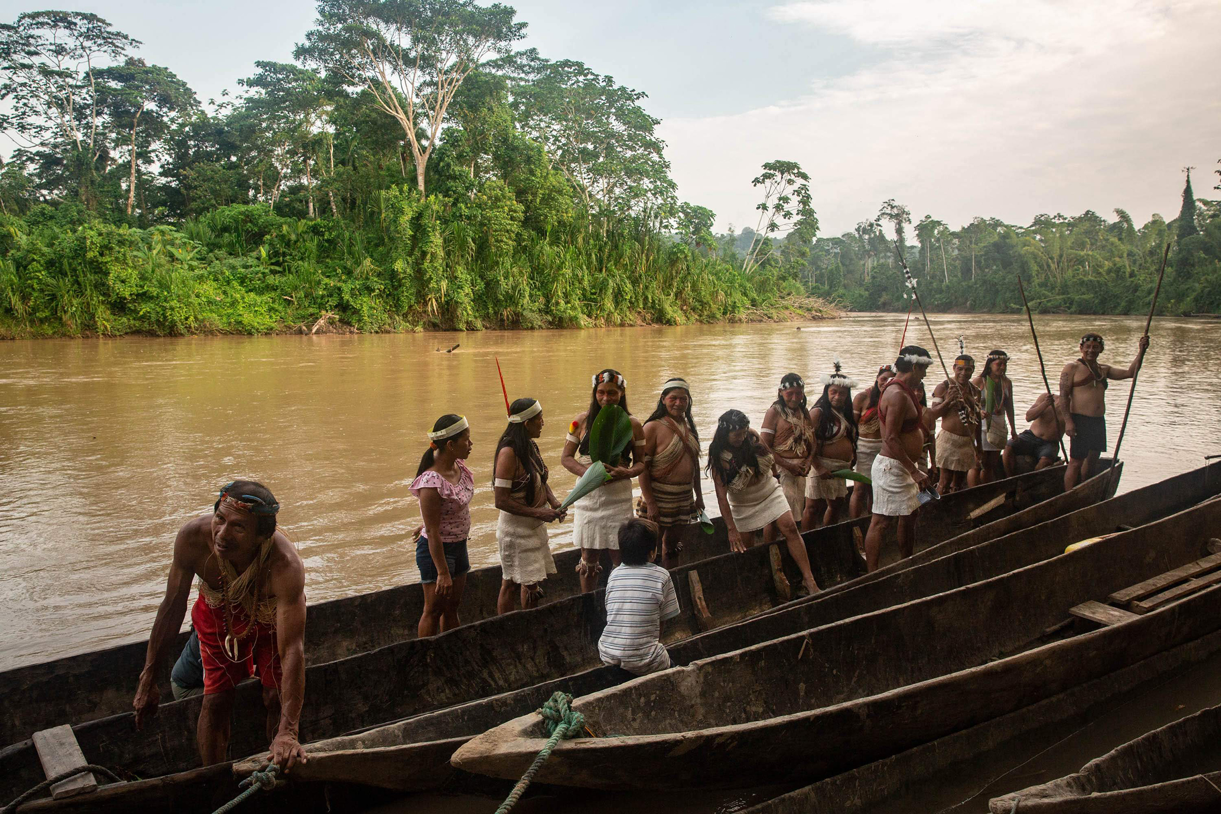 Waorani people embark on a canoe journey along the Curaray river in ancestral Waorani territory, Ecuadorian Amazon, in March.