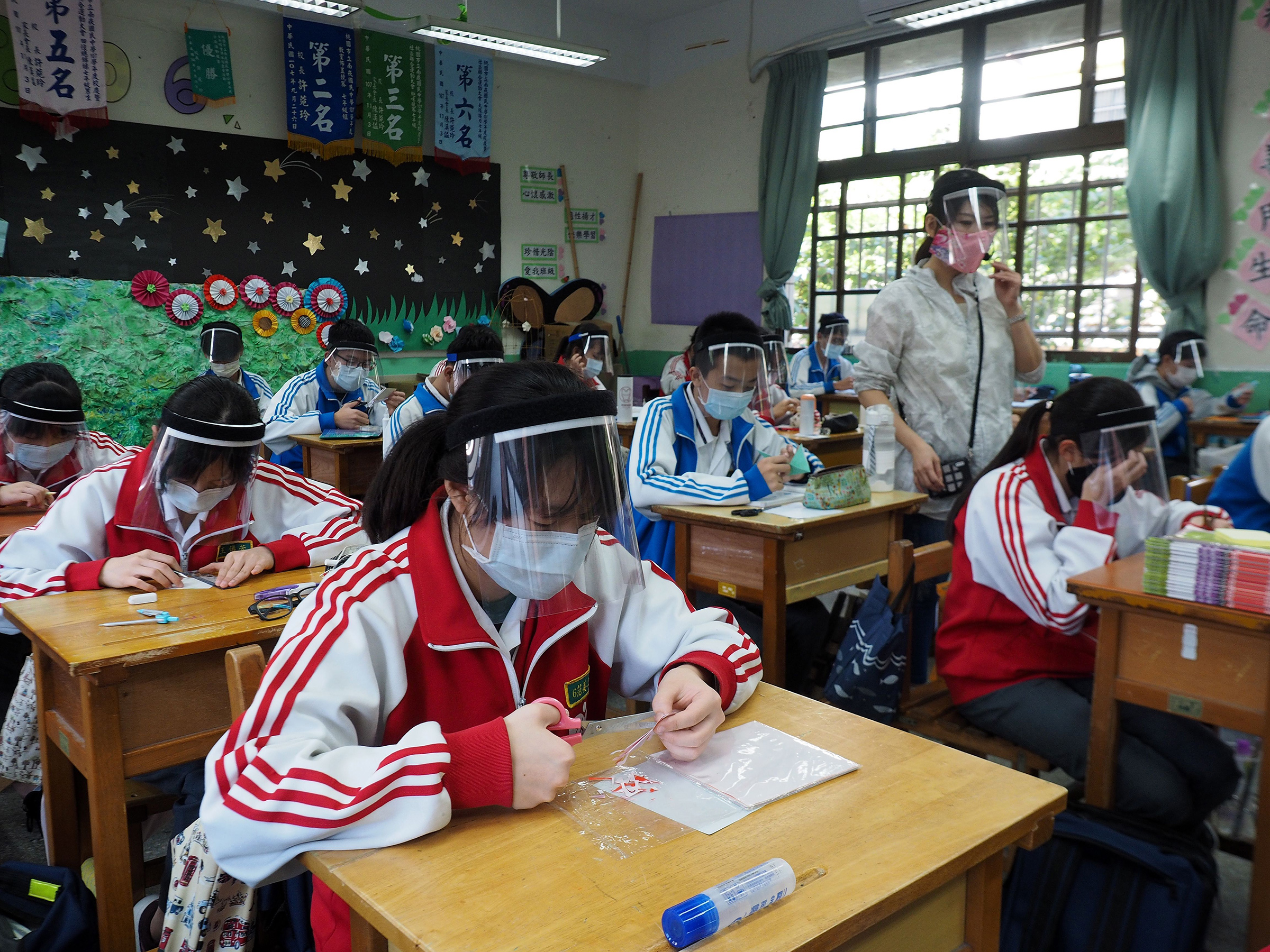 Taiwan: Fewer than 500 cases have been                     confirmed on the island of 23 million, where students in a plastic-arts class seen on April 28                     learned to make                     face shields