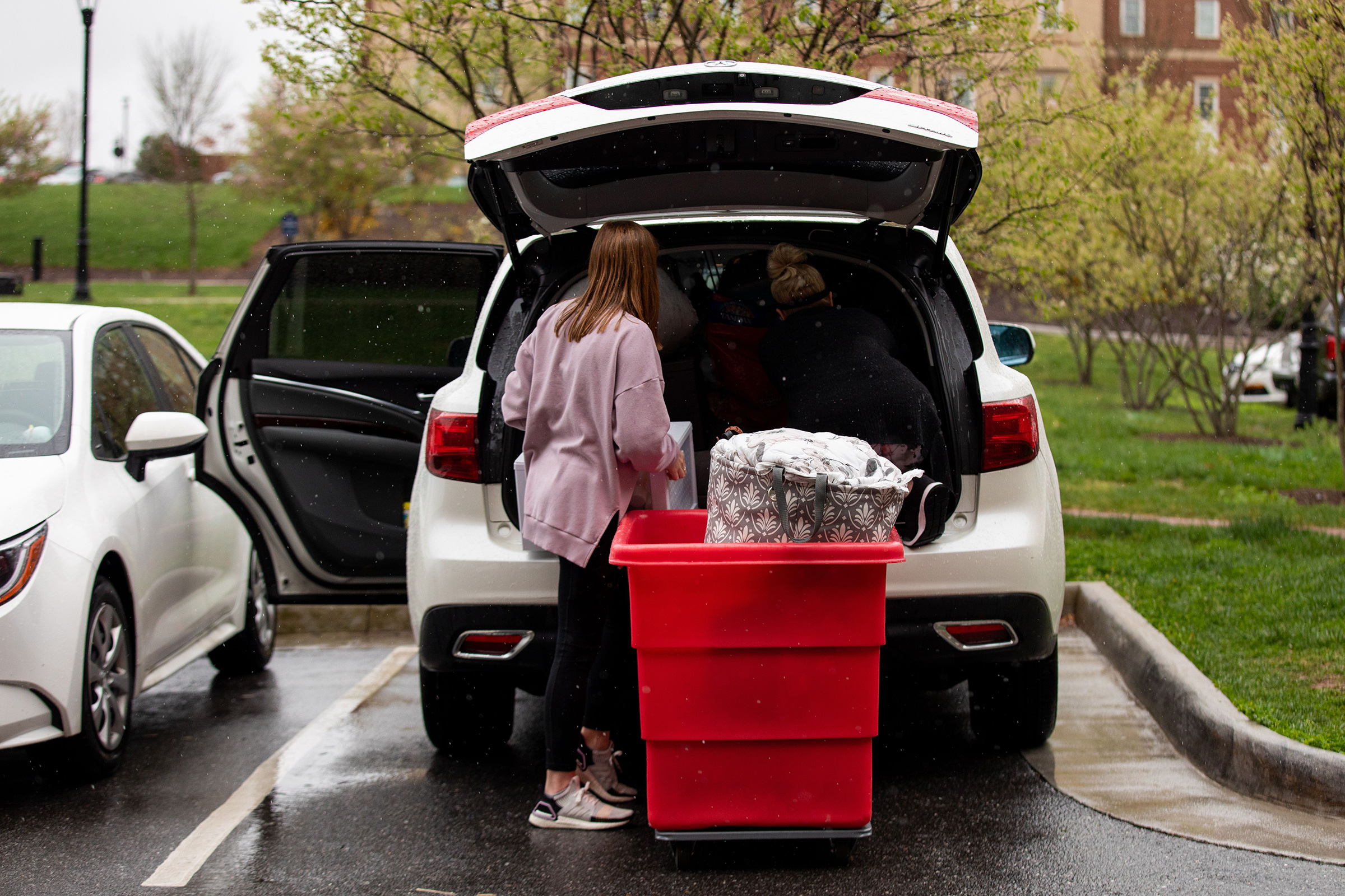 A mother helps her daughter, a student at Liberty University in Lynchburg, Virginia, move out of her dorm on March 31, 2020.