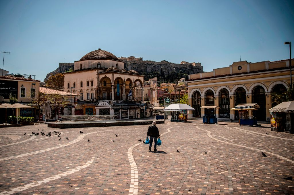 A man walks through the empty Monastiraki square, in central Athens on April 9, 2020, as the country remains under lockdown to stop the spread of COVID-19 disease caused by the novel coronavirus.