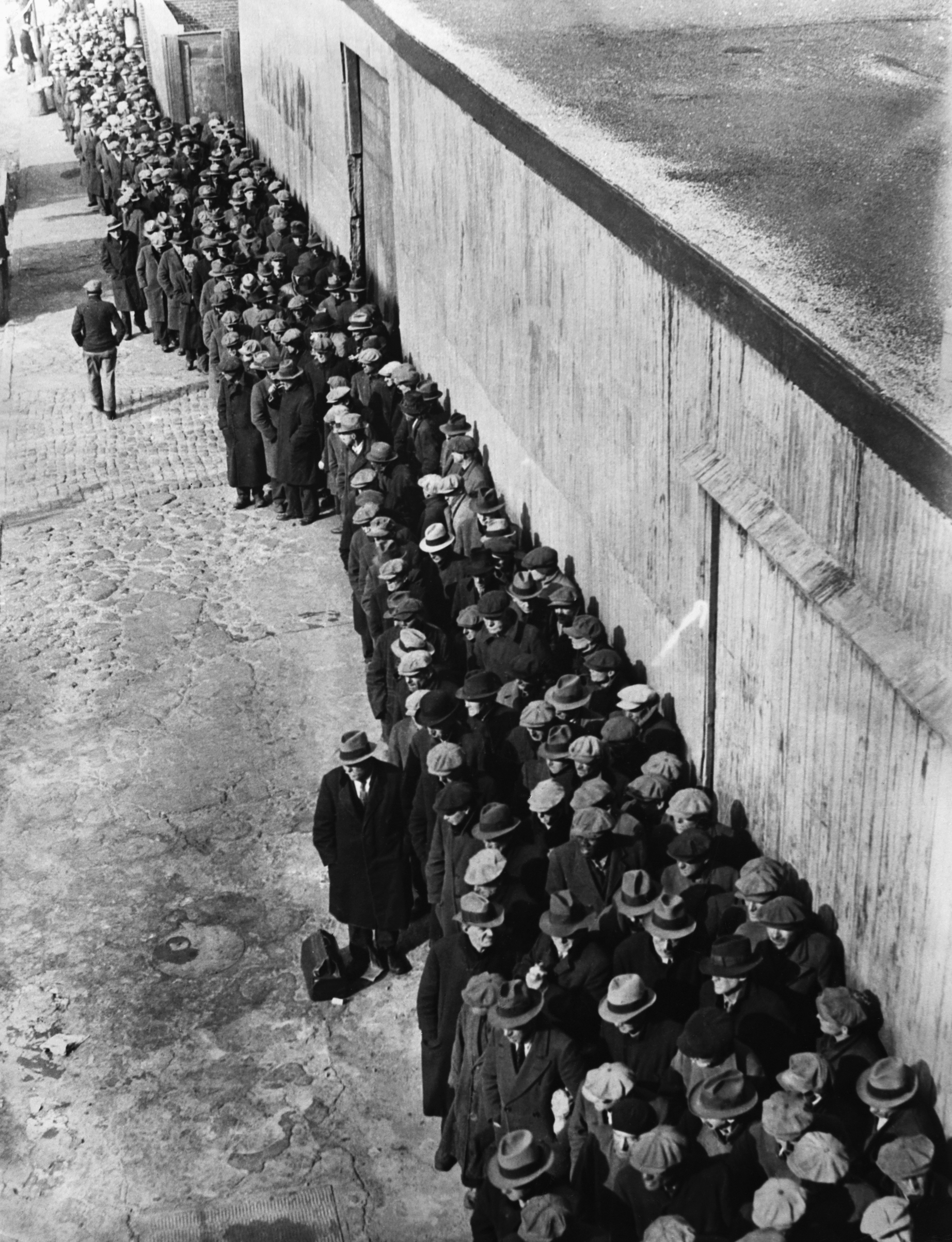 New Yorkers queue at a soup kitchen set up by Mayor La Guardia in 1935