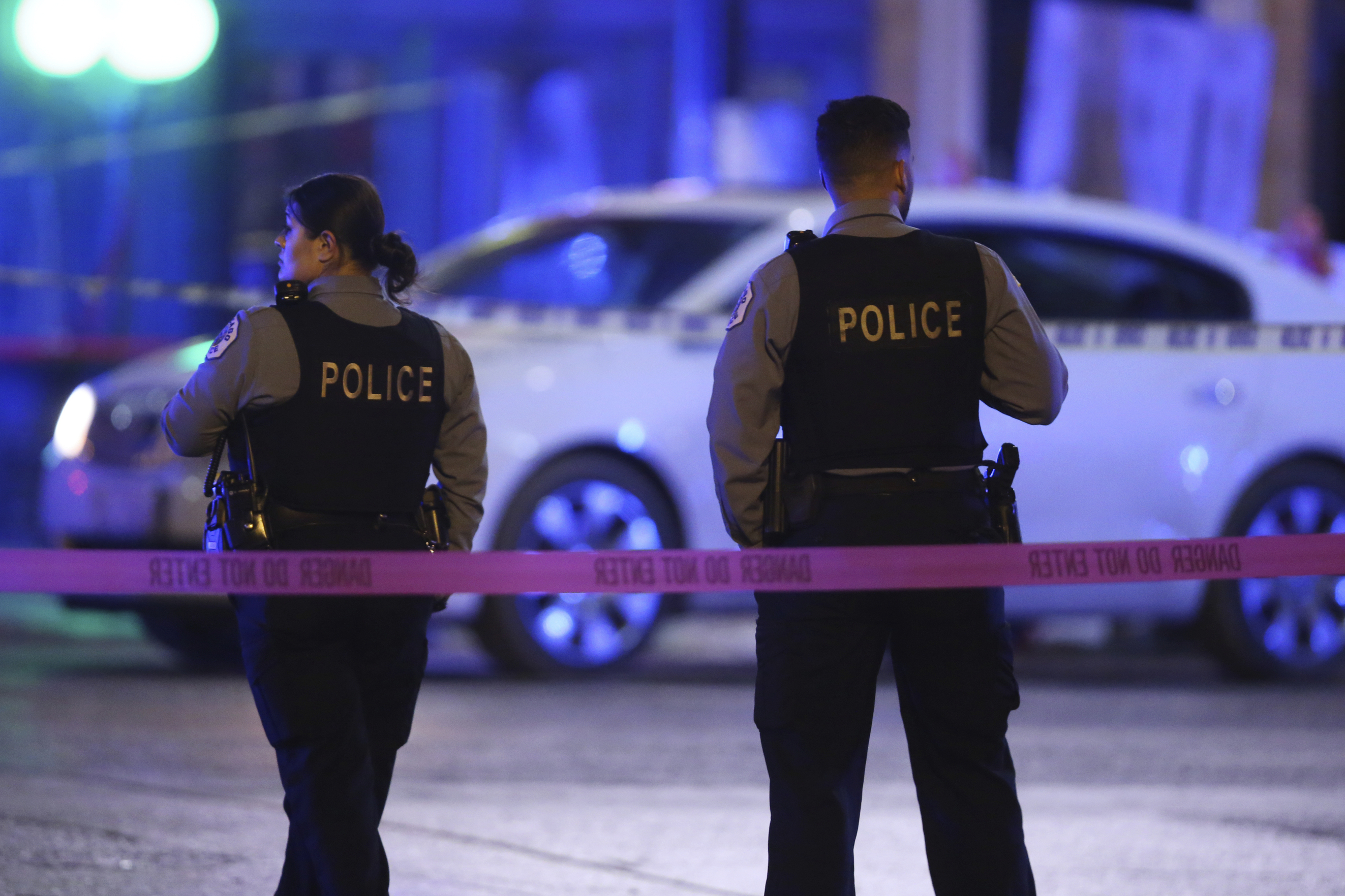 Police work a crime scene  in Chicago on Nov. 19, 2019. Despite a statewide shelter-in-place order in an attempt to stop the spread of the coronavirus, the city is still facing high levels of gun violence.