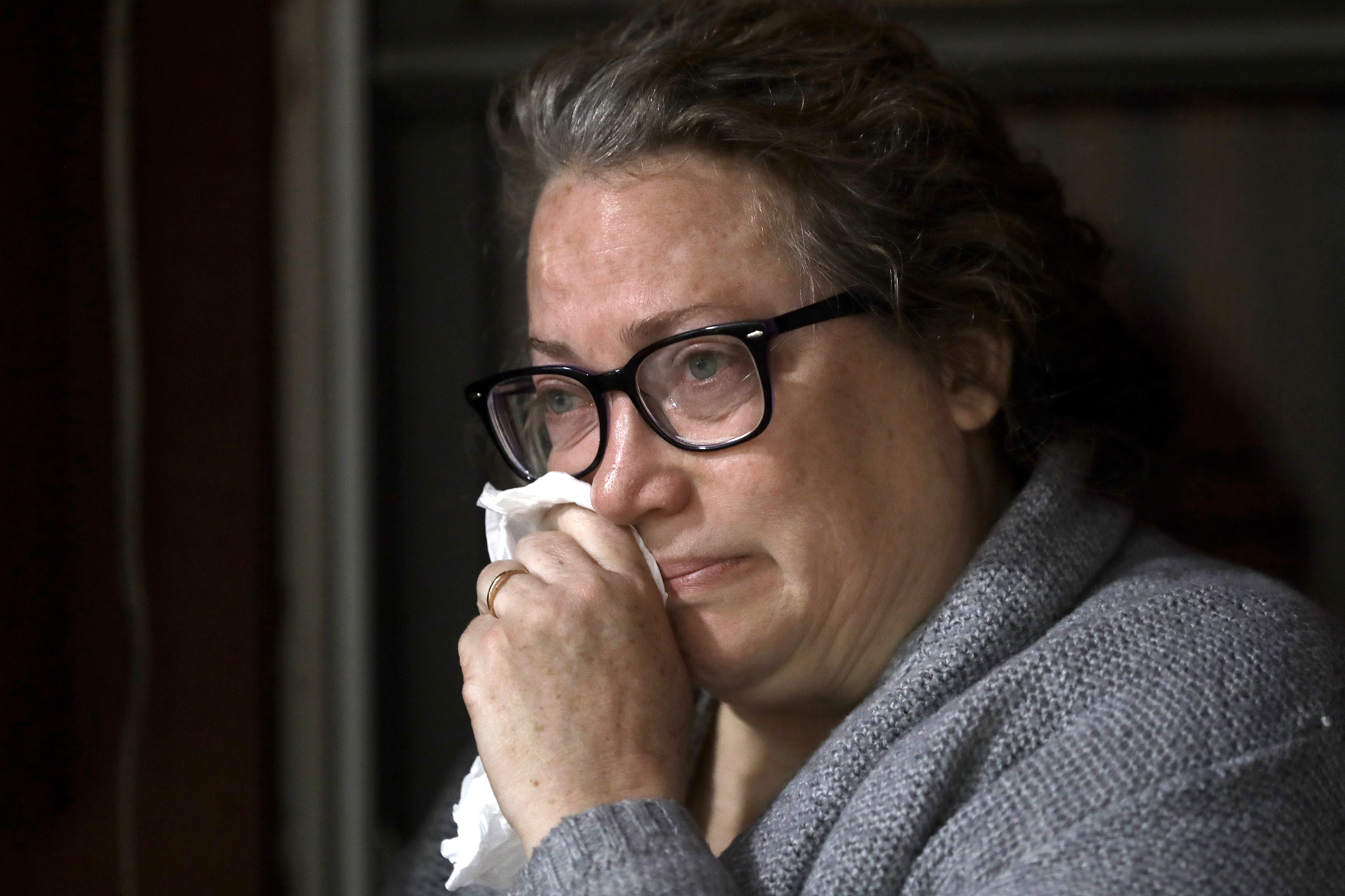 Susan Kenney, of Ware, Mass., who lost her father to the coronavirus, is tearful while speaking to a reporter from The Associated Press on the front porch of her home, Thursday, April 30, 2020, in Ware.