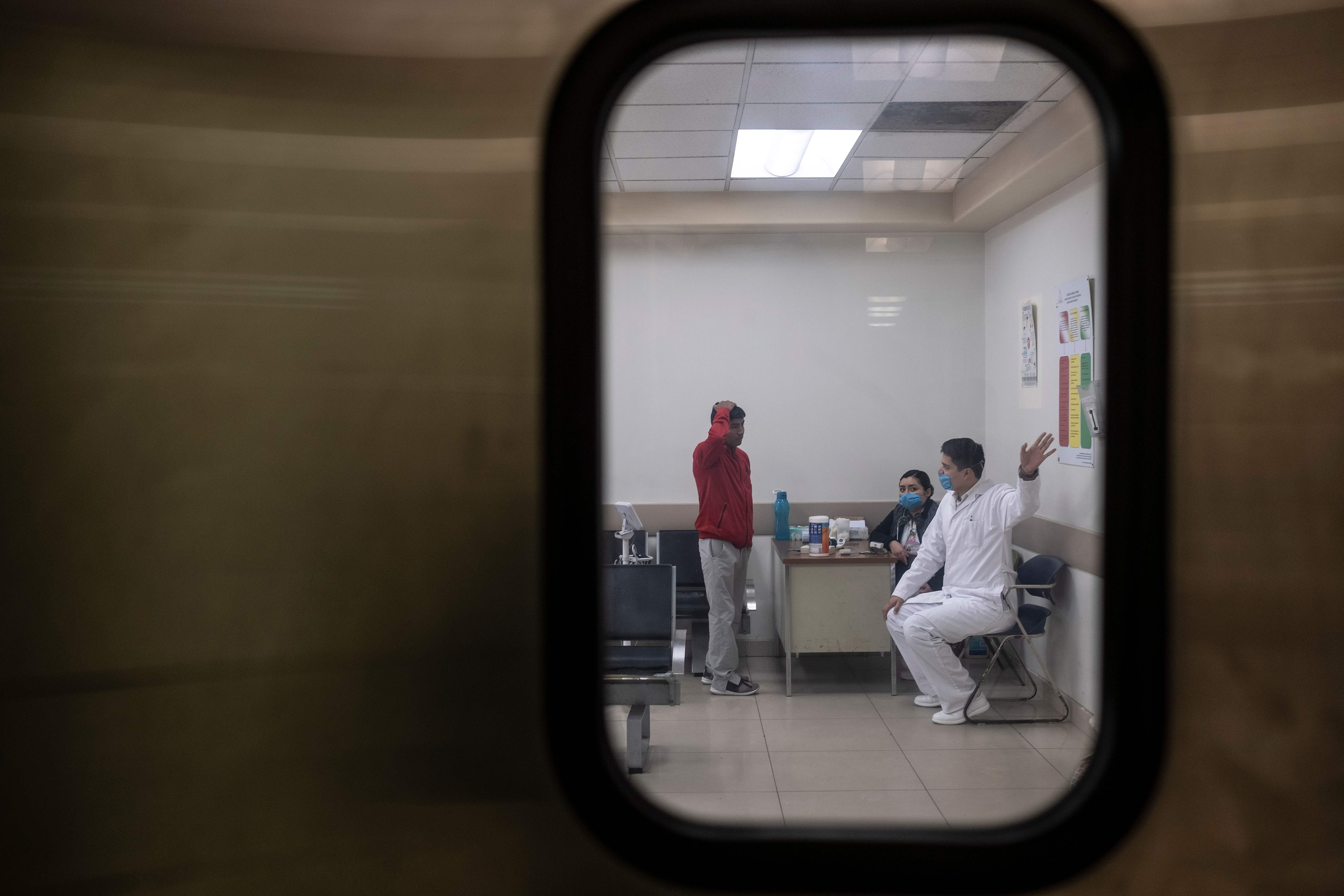 A doctor gives directions to a an arriving patient at a hospital in Tijuana, Mexico, on March 2, 2020.