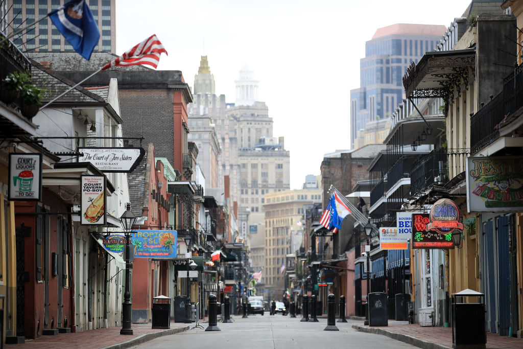 A view of empty Bourbon street in the French Quarter amid the coronavirus (COVID-19) pandemic on March 27, 2020 in New Orleans, Louisiana.  Orleans Parish has reported at least 1,170 cases, and recorded 57 deaths from the coronavirus.