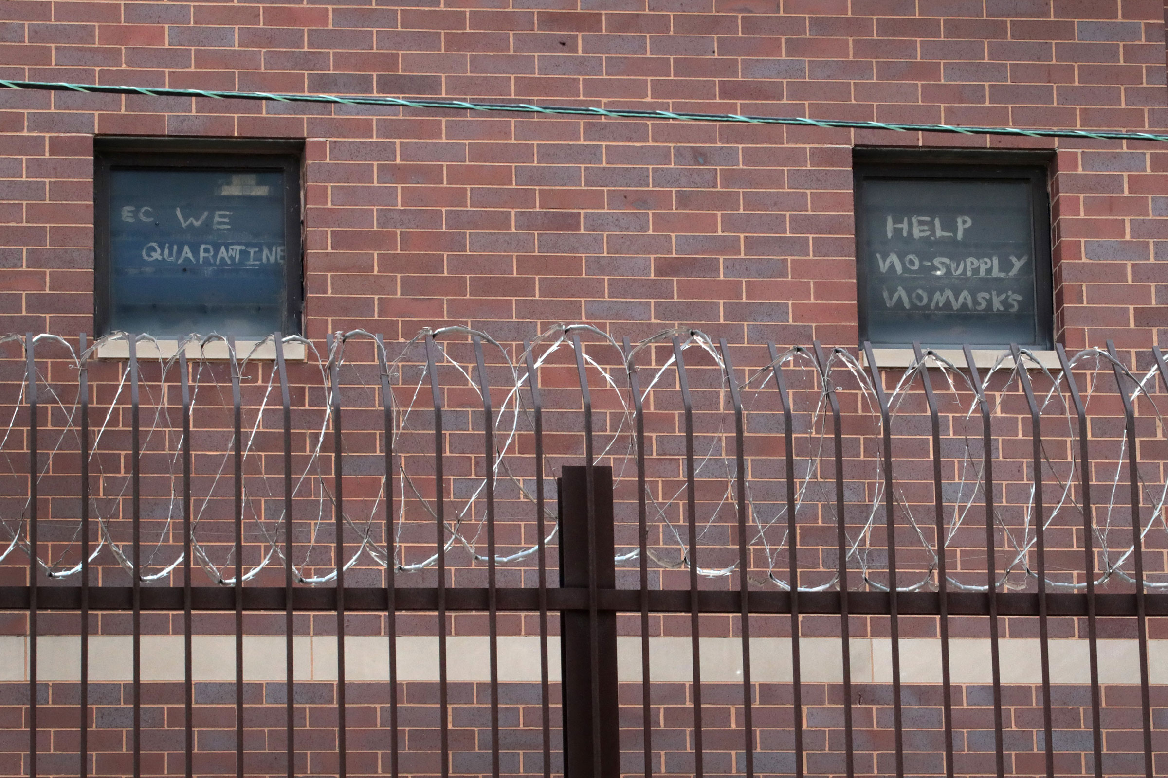 Signs pleading for help hang in windows at the Cook County jail complex on April 09, 2020 in Chicago.