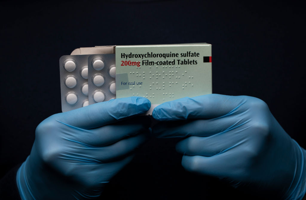 In this photo illustration a pack of Hydroxychloroquine Sulfate medication is held up on March 26, 2020.