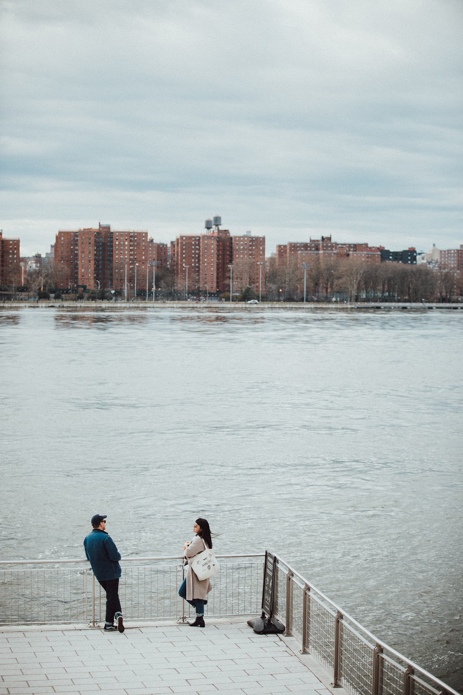 A couple in Domino Park in Williamsburg, Brooklyn on April 4th, 2020.