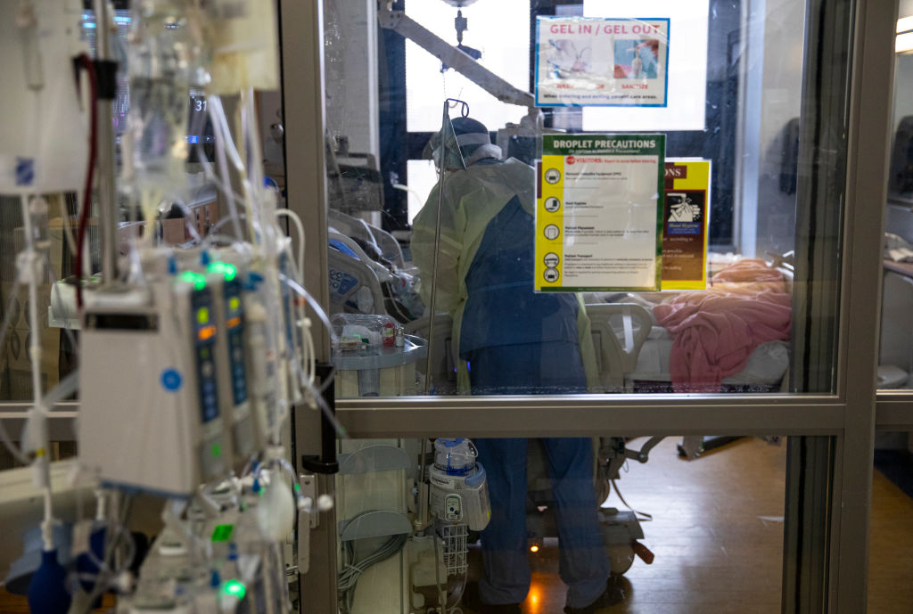 A nurse checks the vital signs of a COVID-19 patient using a ventilator at the Veterans Affairs Medical Center in Manhattan on April 24, 2020.