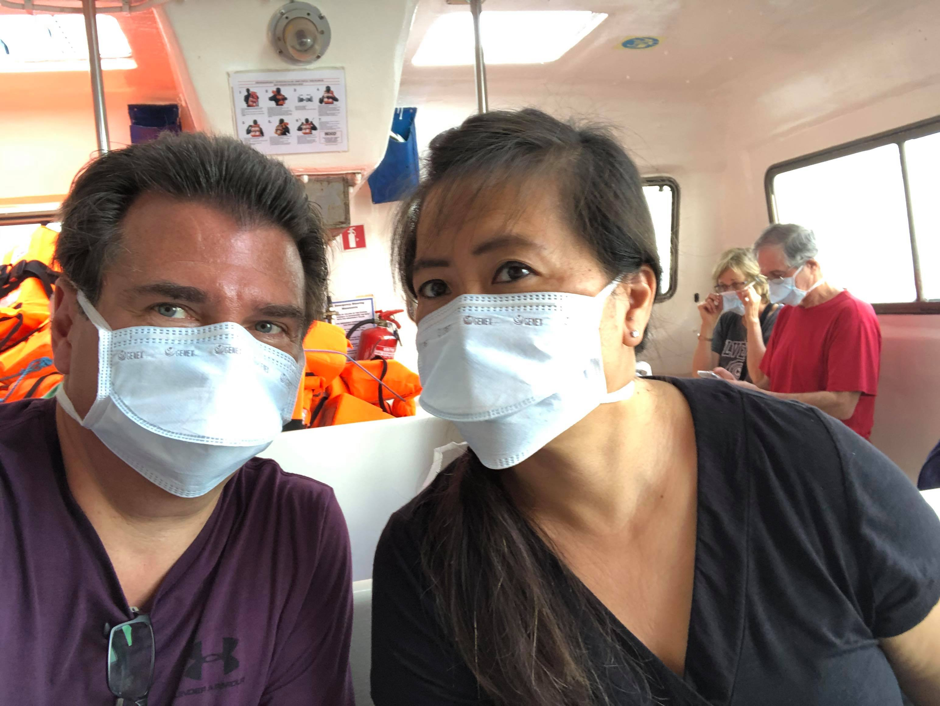 Rick and Wendy de Pinho, passengers aboard the virus-stricken Zaandam cruise ship, pictured during their transfer to the Rotterdam cruise ship on Sunday.