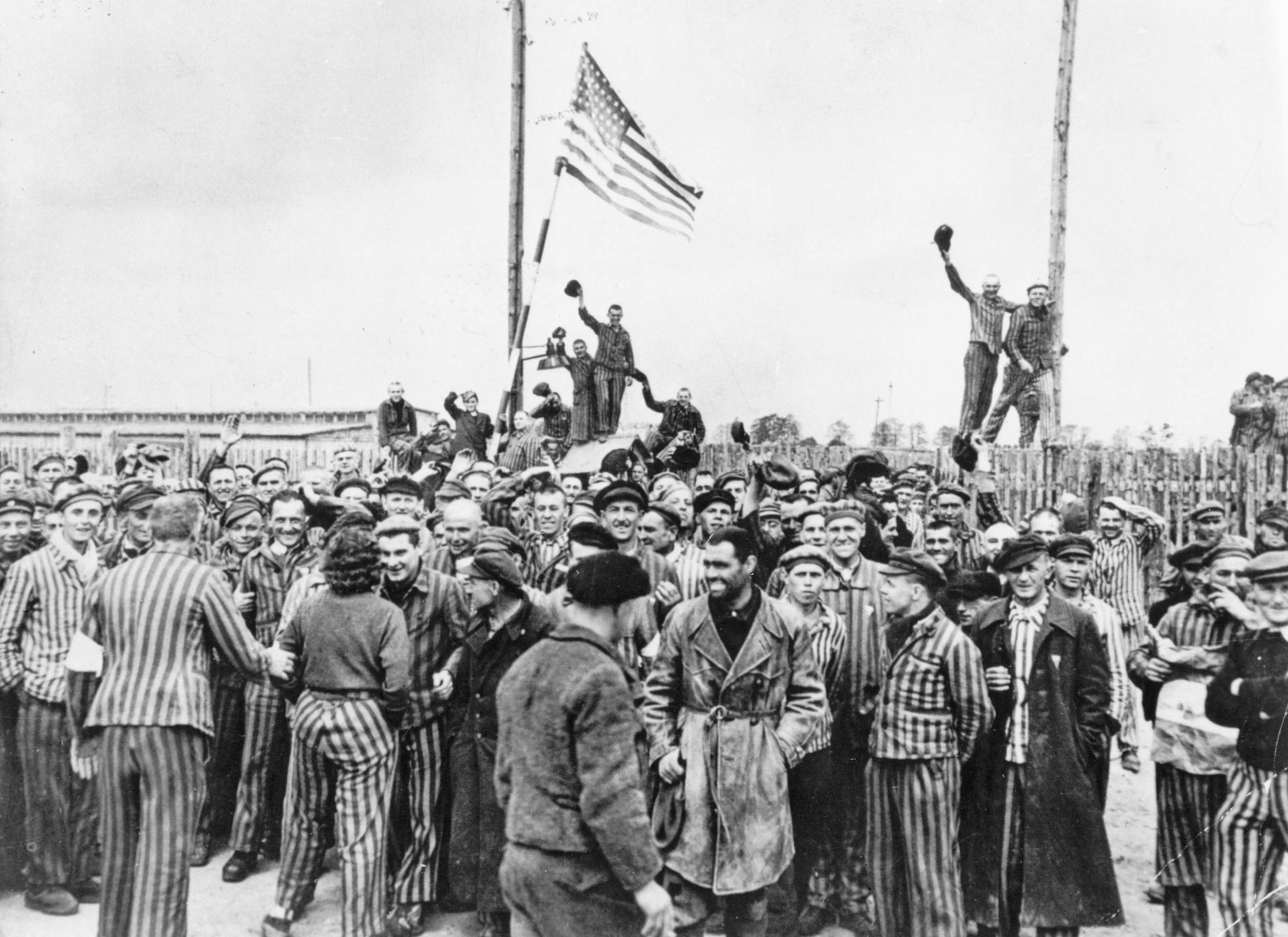 Detainees from Dachau concentration camp gathering on the former place of roll call after the liberation by American soldiers in 1945