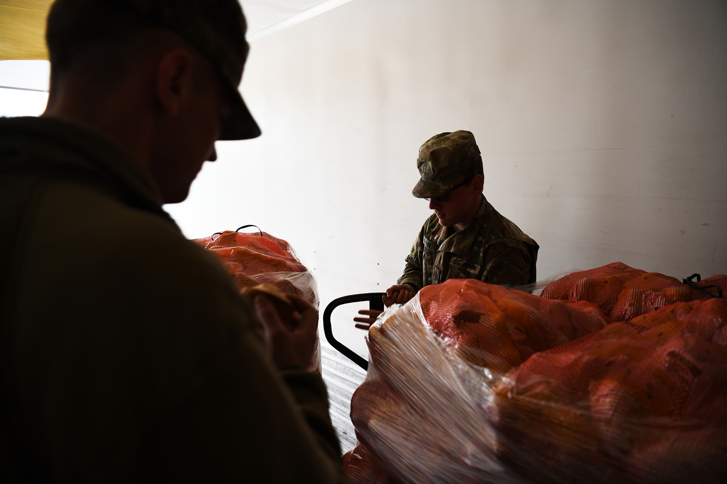 Soldiers unload food at the Dayton Foodbank in Dayton, Ohio, on April 21, 2020.