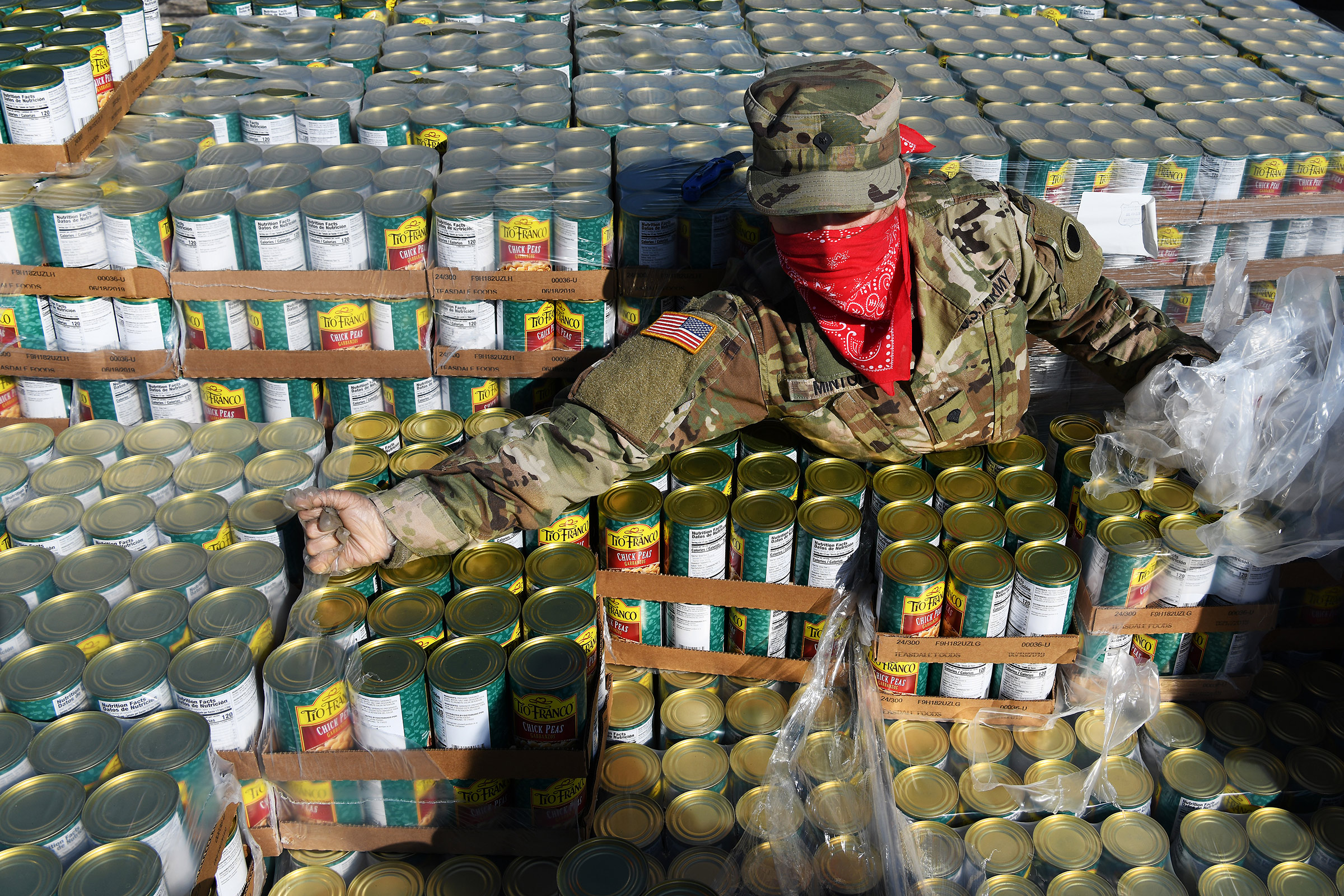 U.S. Army Spc. Rose Minton unpacks pallets of food at Wright State University's Nutter Center in Fairborn, Ohio, on April 21, 2020.